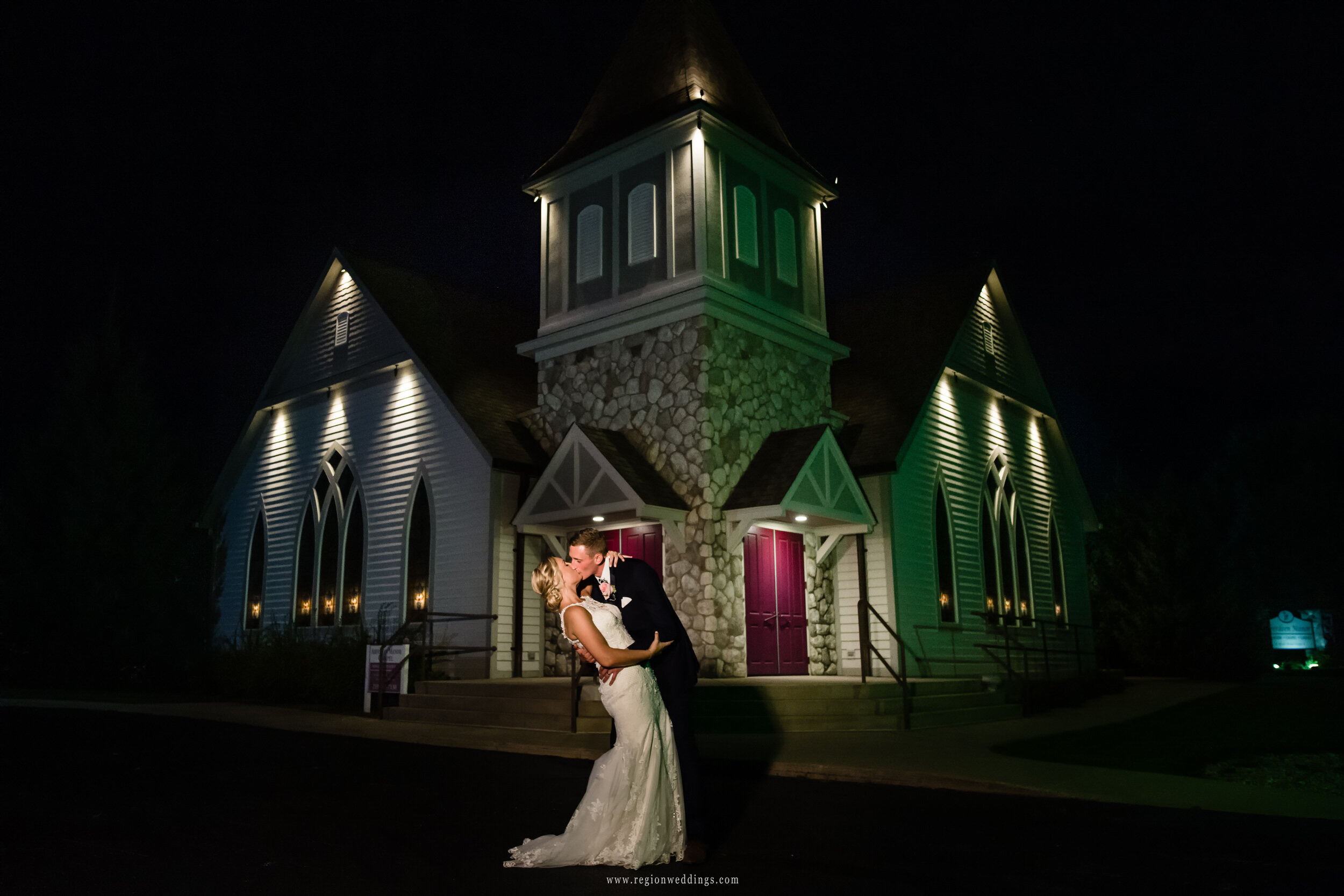 Night photo of the bride and groom in front of the Aberdeen Chapel.