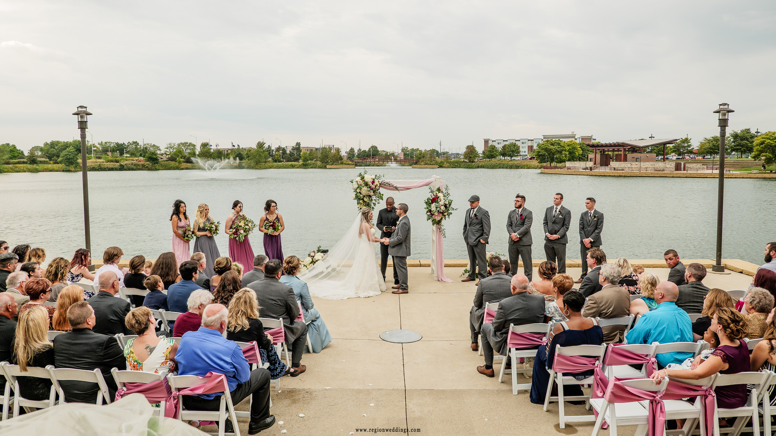 Outdoor wedding in September at the Centennial Park terrace overlooking the lake.