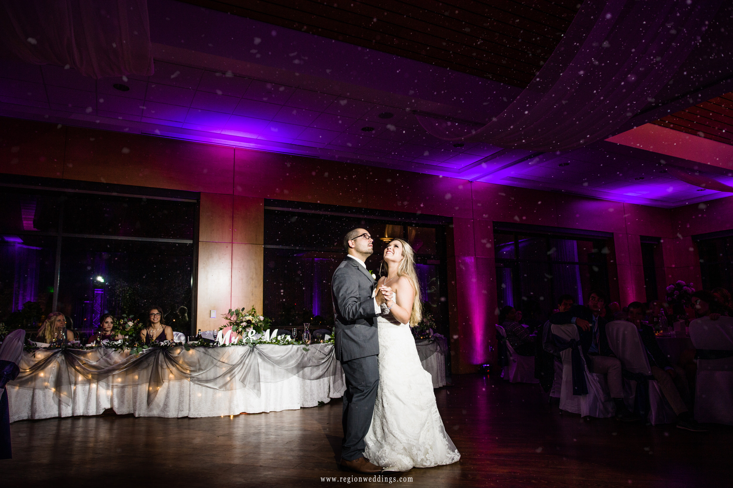 Snow descends upon the dance floor at a Centennial Park clubhouse wedding reception.