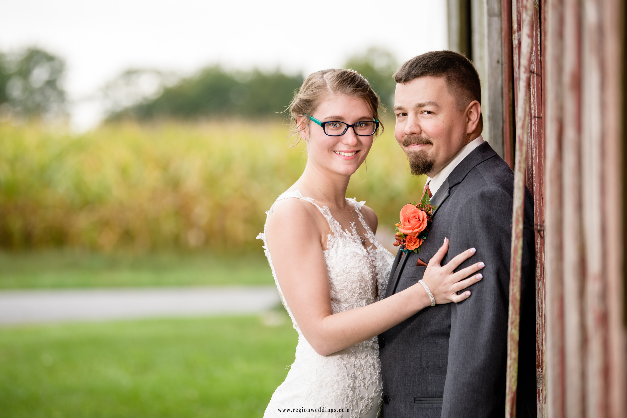 Bride and groom barn portrait at Four Corners Winery.