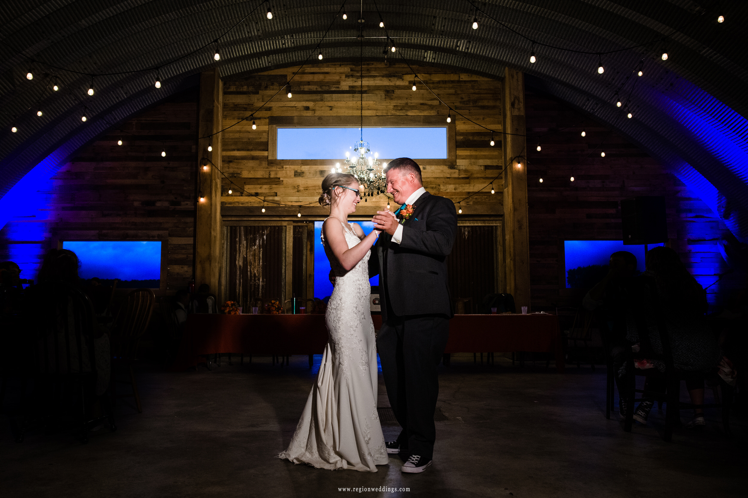 The father and daughter dance at Four Corners Winery.