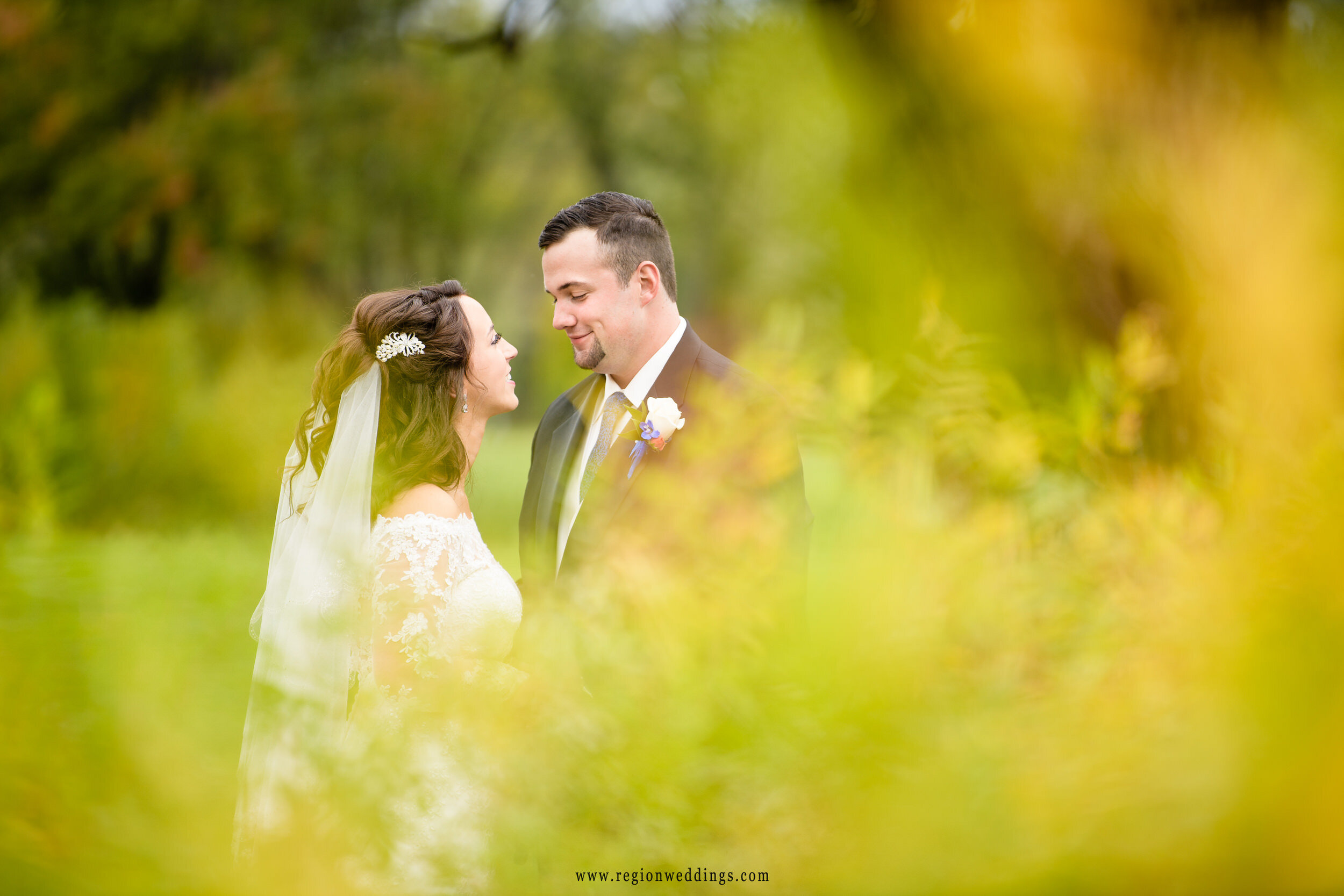 Autumn yellow surrounds the bride and groom at Wicker Park.