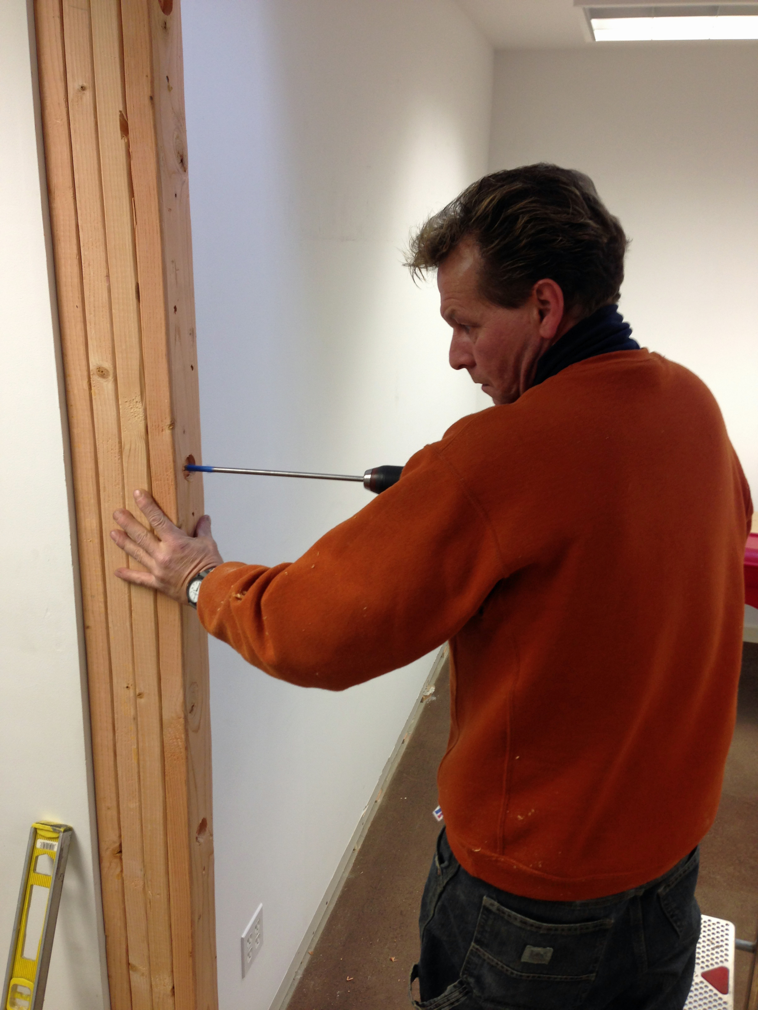 I was privileged to have my friend and master woodworker Sean Smith come to help with the project.  Here Sean is anchoring the new wall.