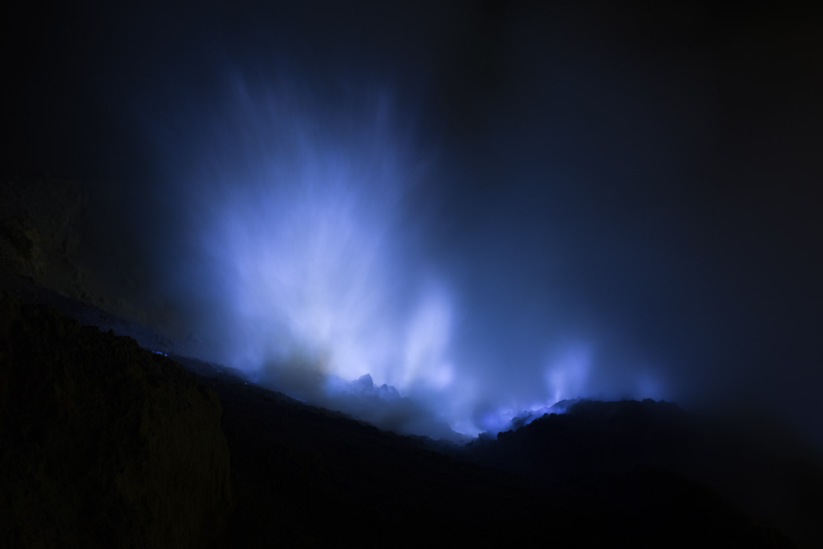 The blue flames of sulphur burning in the crater of Mount Ijen, Java, Indonesia September 2016. ©Laurence Gibson