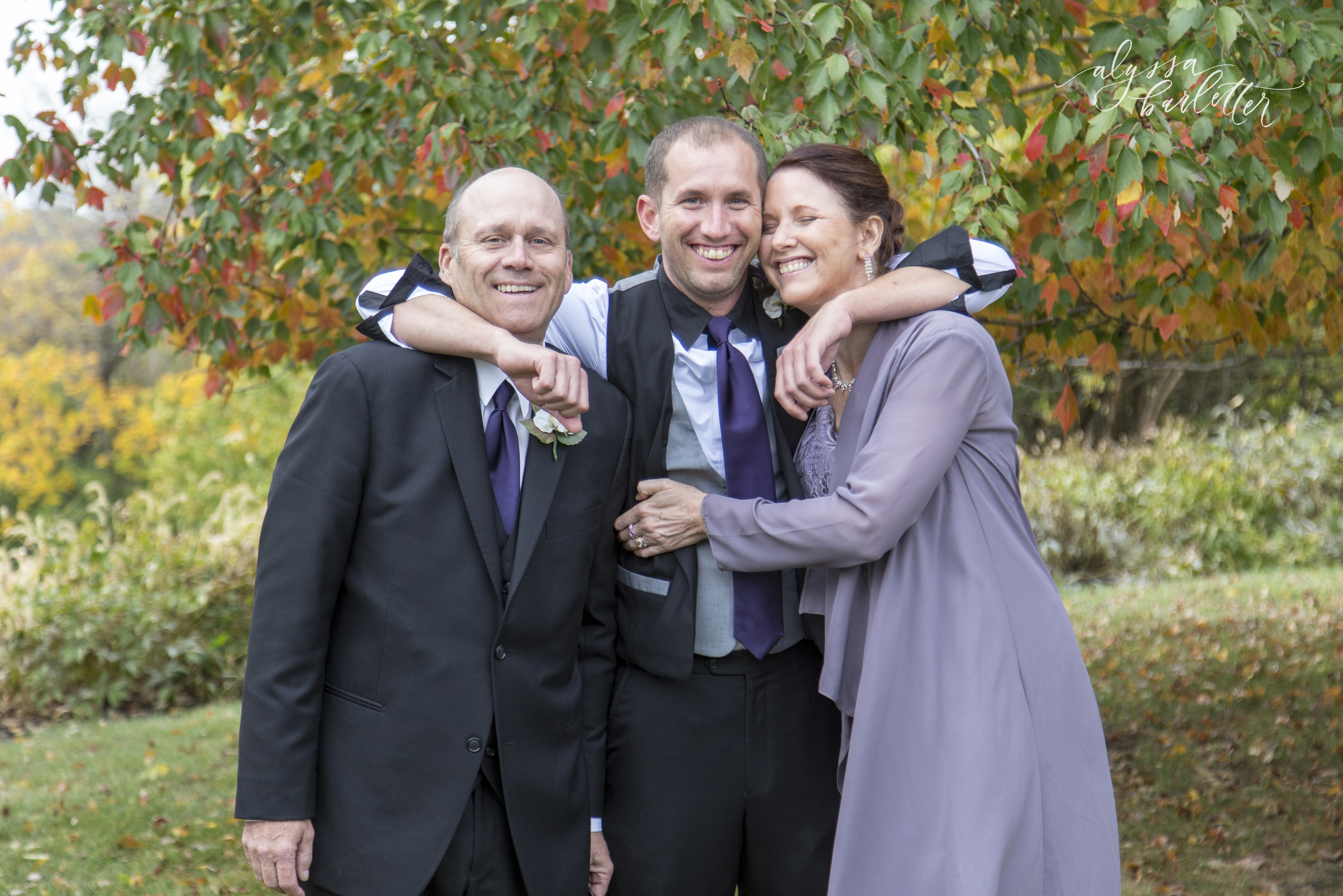 wedding photography family formals group posing fun parents groom