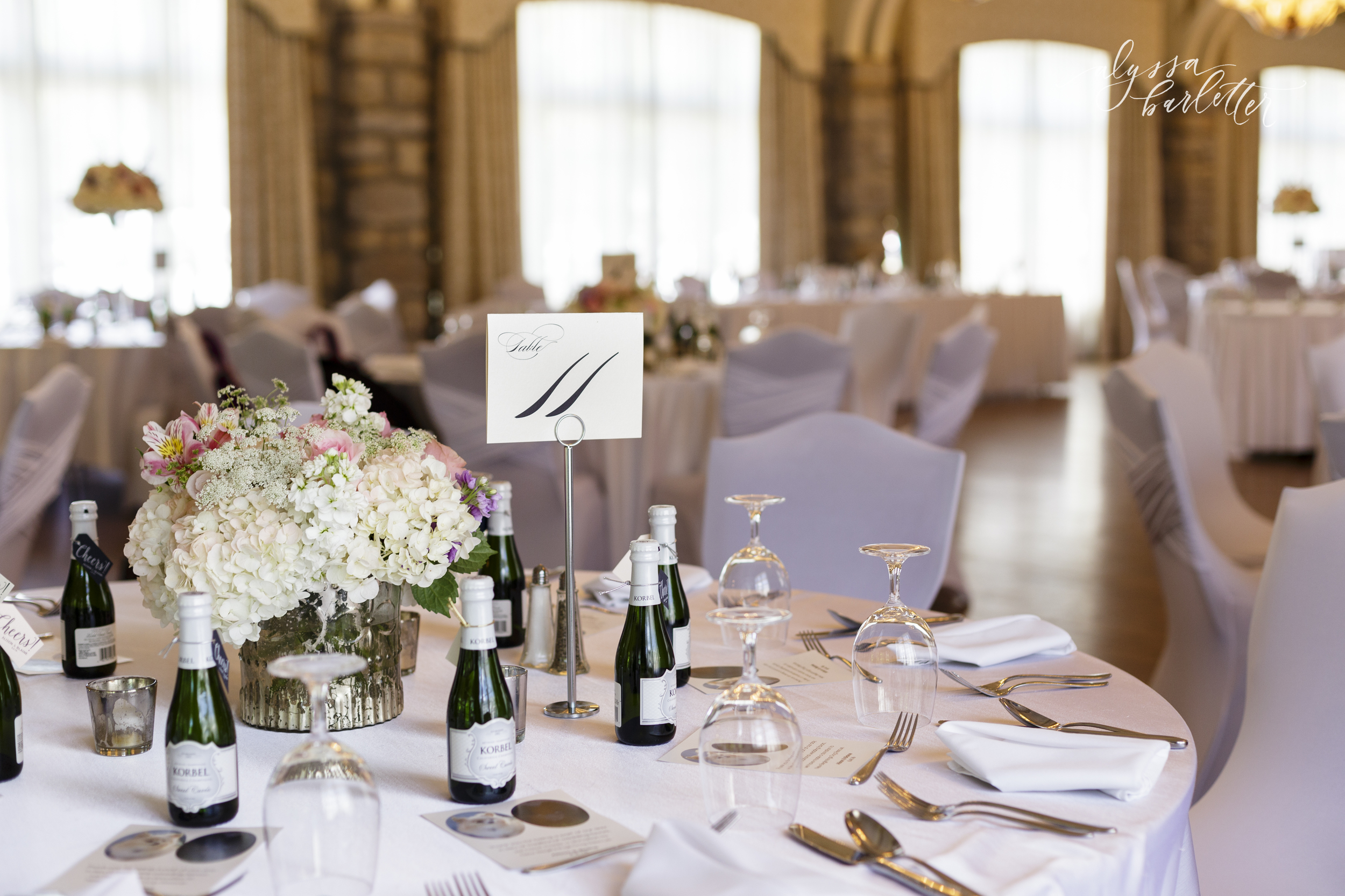 kansas city wedding photography centerpiece table reception pink champagne the elms hotel and spa ballroom