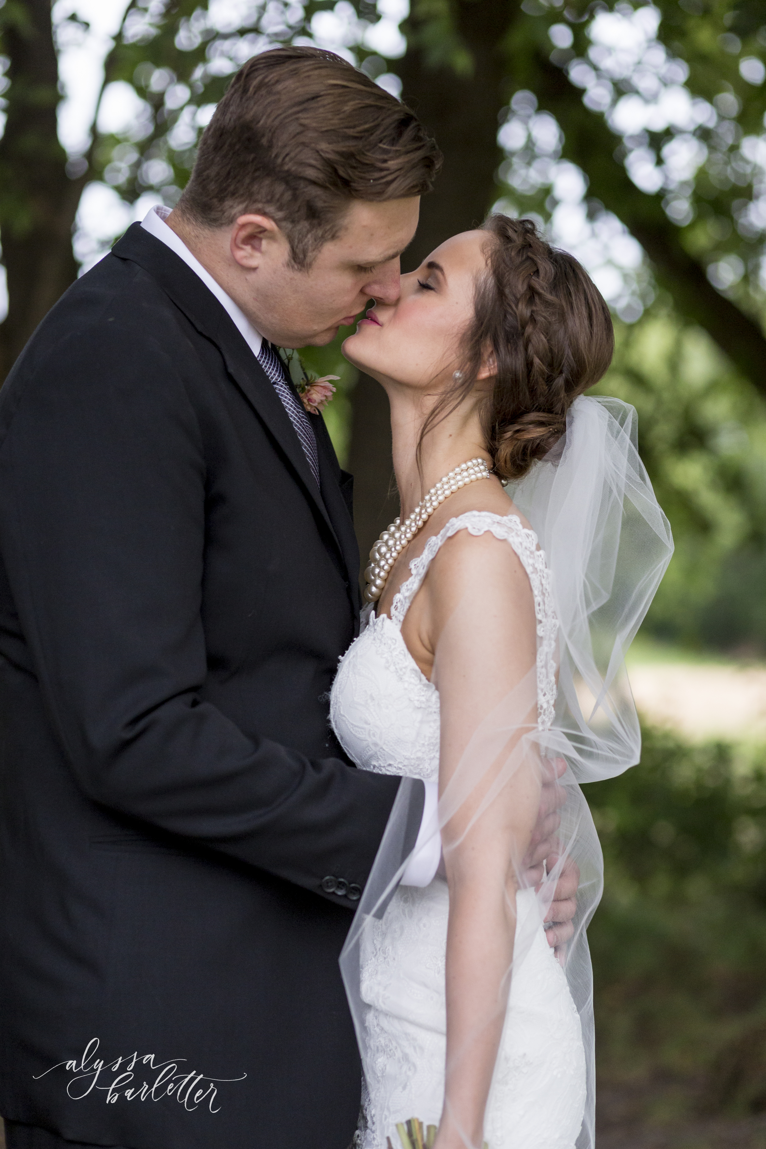 kansas city wedding budget mahaffie bride groom kiss portraits veil