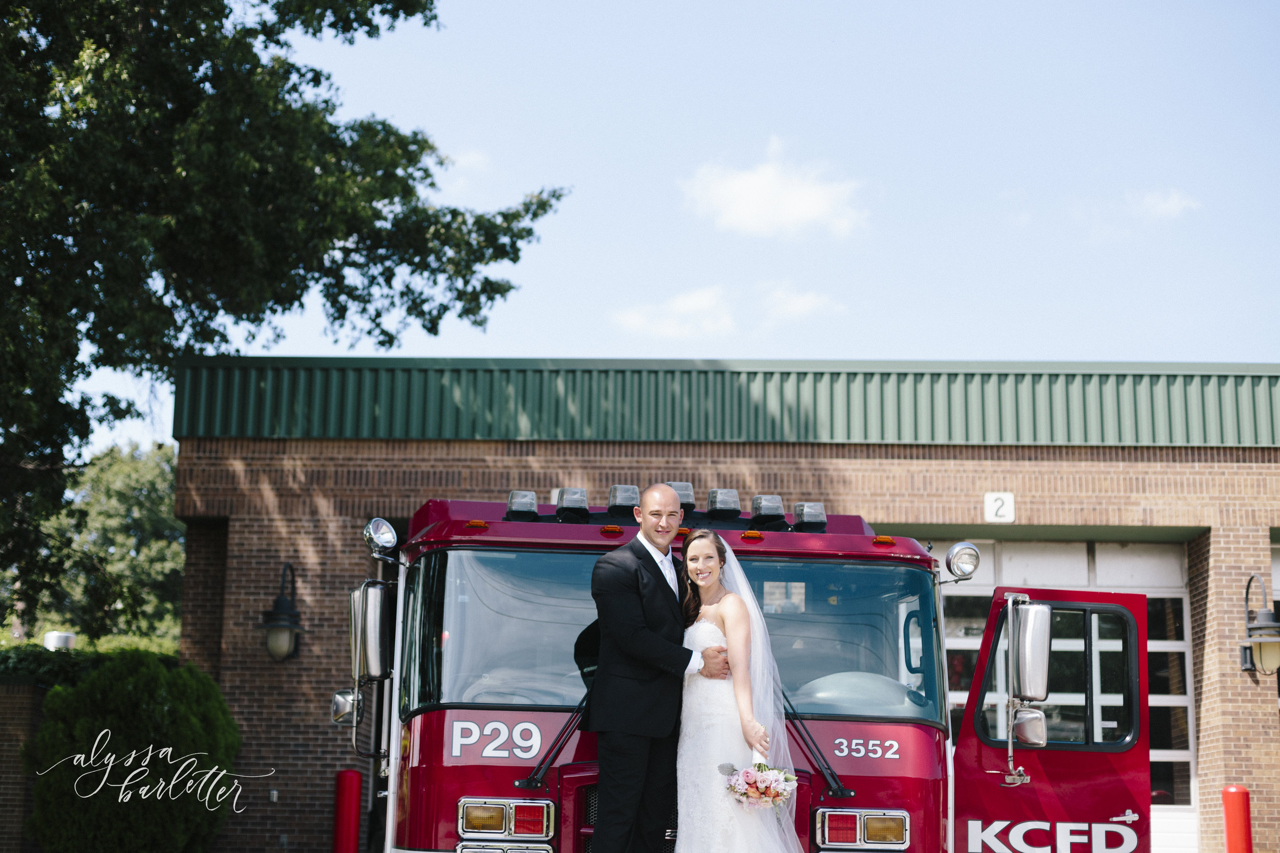 kansas city wedding photography fireman firetruck fire station bride groom