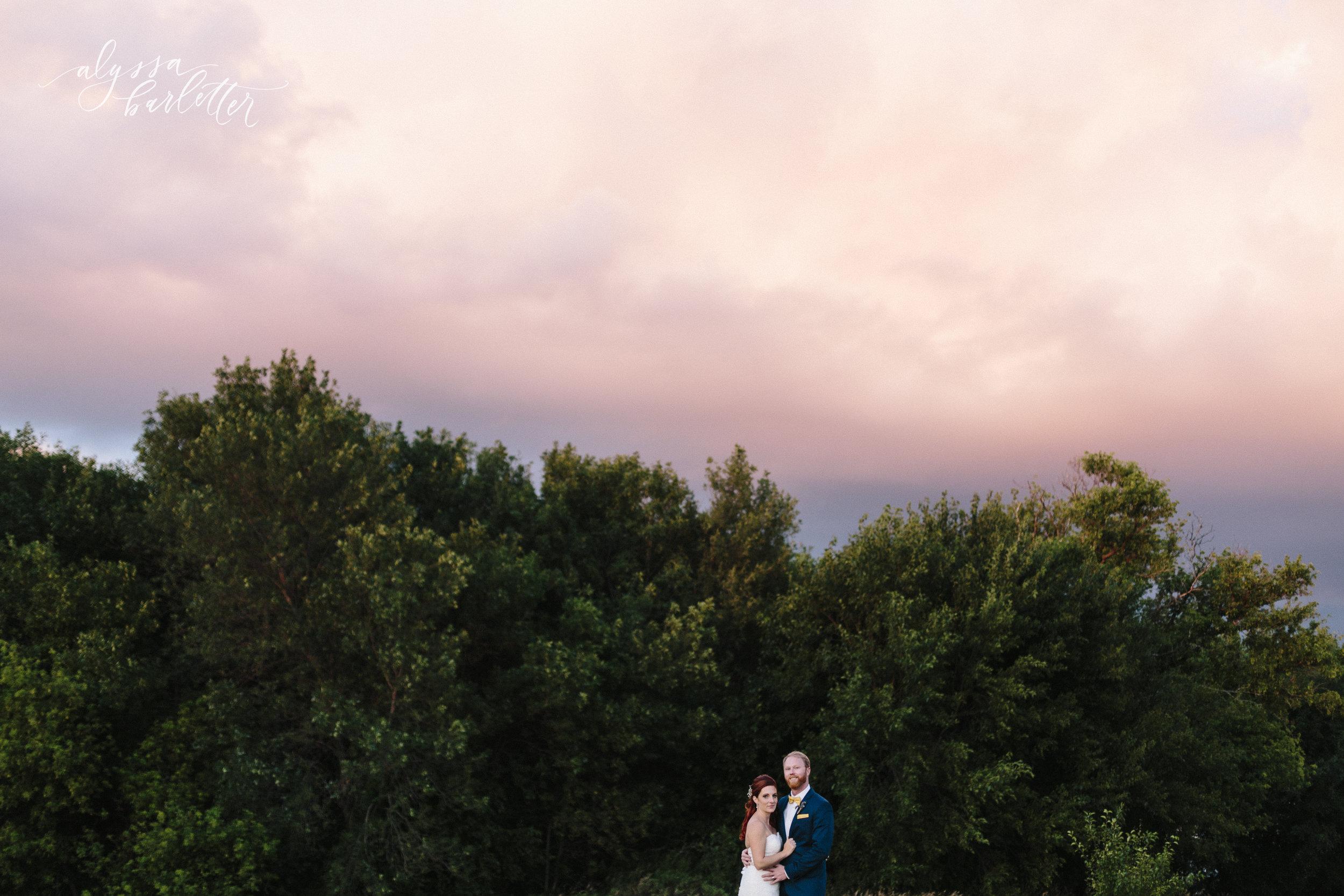 manning iowa wedding photographer german hausbarn sunset clouds