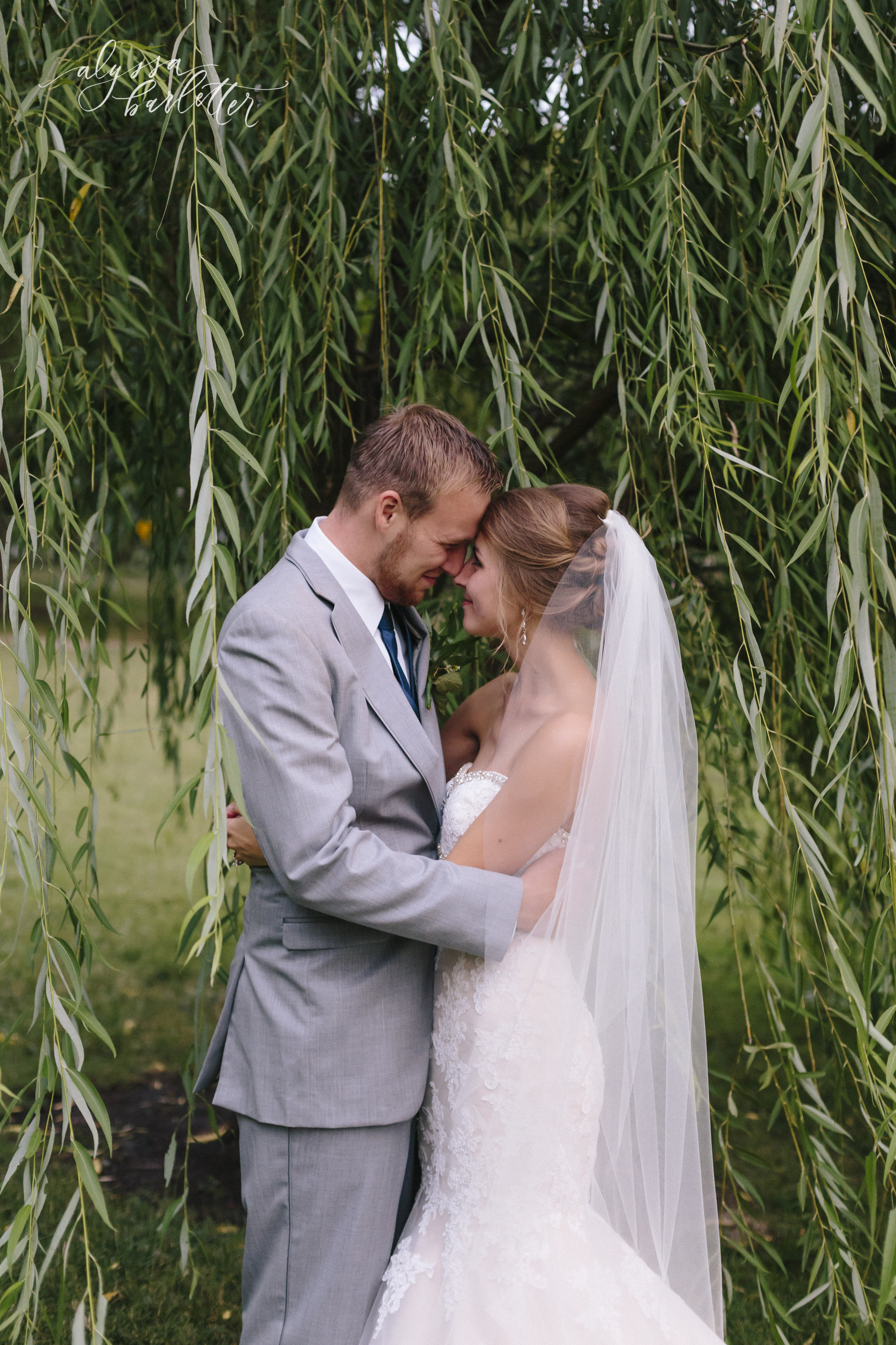 bride and groom grey suit sweetheart neckline fitted lace dress willow tree loose park kansas city wedding photography photographer