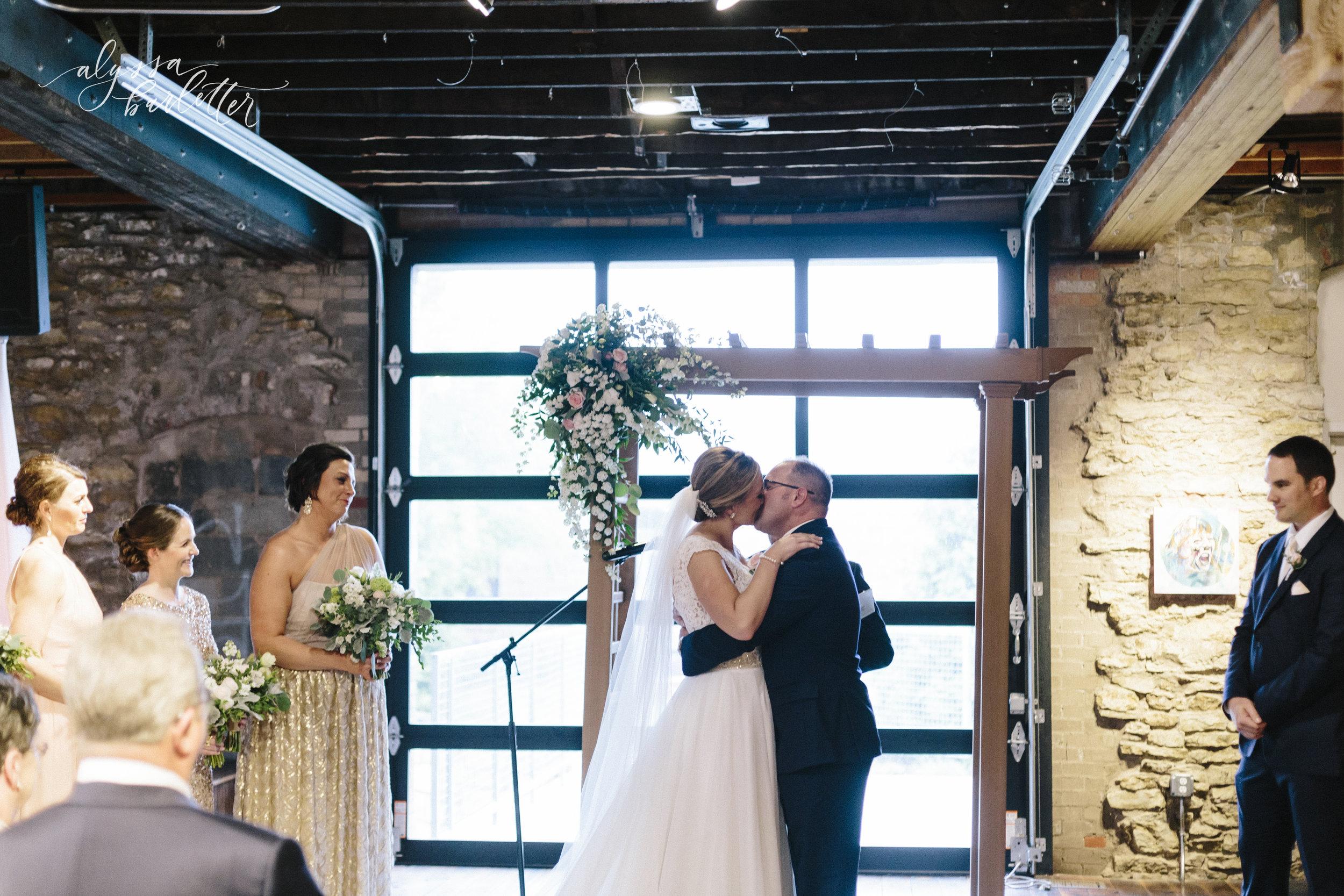 alyssa barletter photography cider gallery lawrence kansas rainy day wedding megan and brett-1-39.jpg