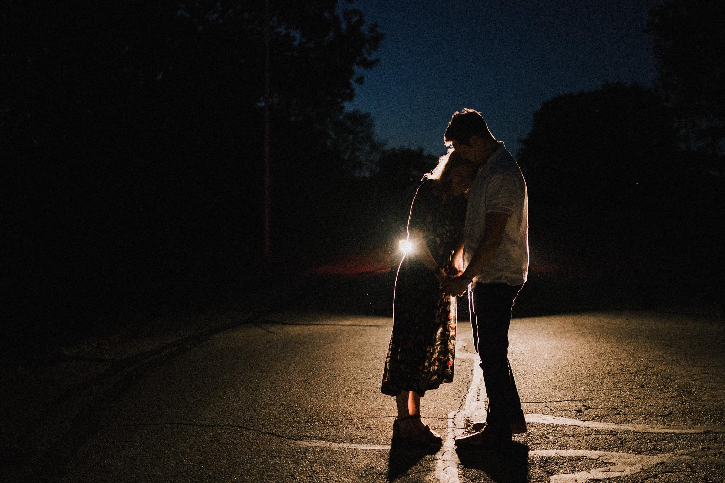 alyssa barletter photography artsy engagement photos headlight car nighttime fun-9.jpg