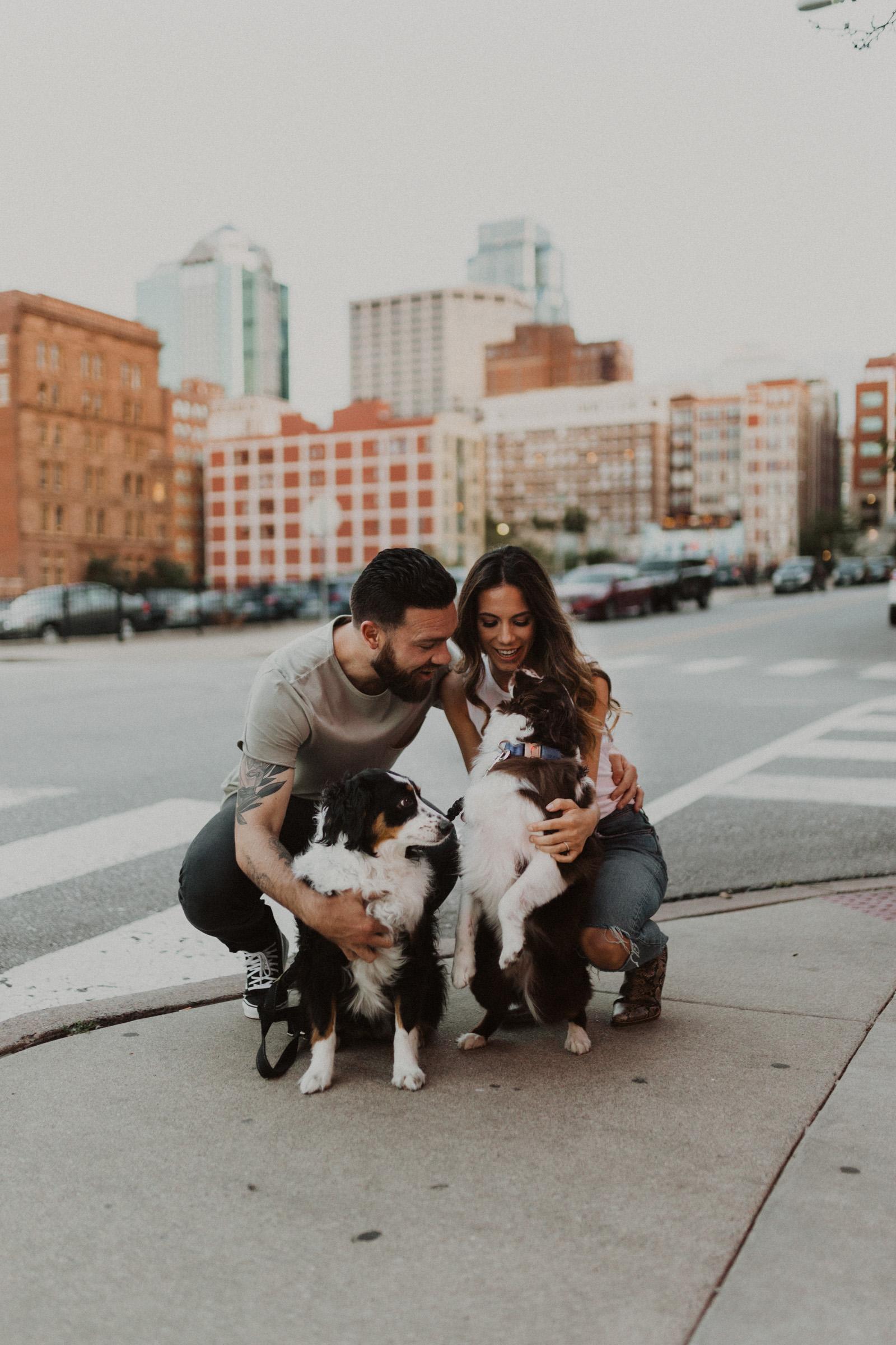 alyssa barletter photography downtown kansas city photos with couple and aussies austrailian shepards-16.jpg