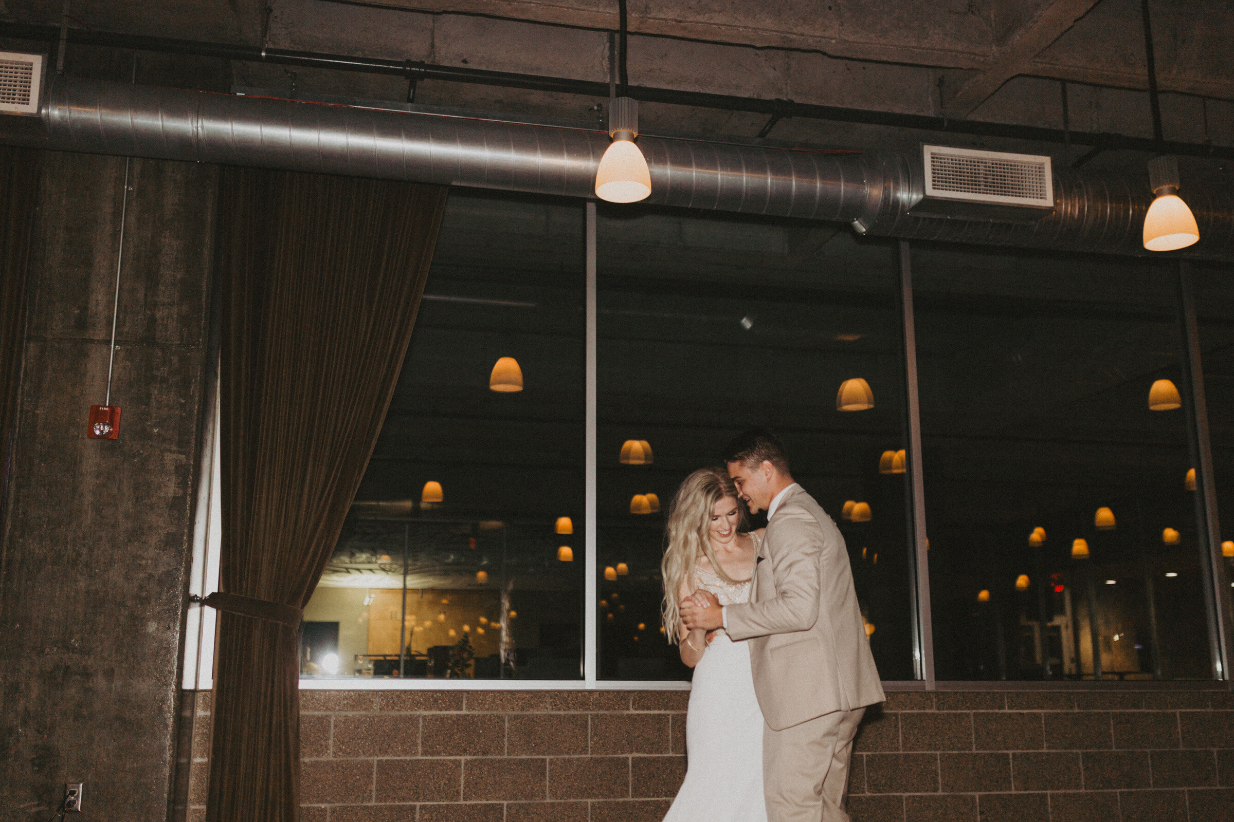 alyssa barletter photography downtown kansas city wedding boulevard brewery reception rainy day wedding-61.jpg