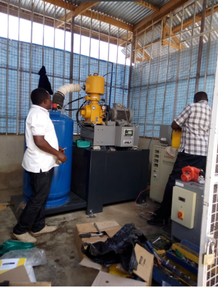 Erasto Katowo HALI project LN plant operator working with an engineer from CRYOTECH COMPANY DavId Githinji during maintenance of the plant on April 4, 2017  (PHOTO BY Sijali Zikankuba)