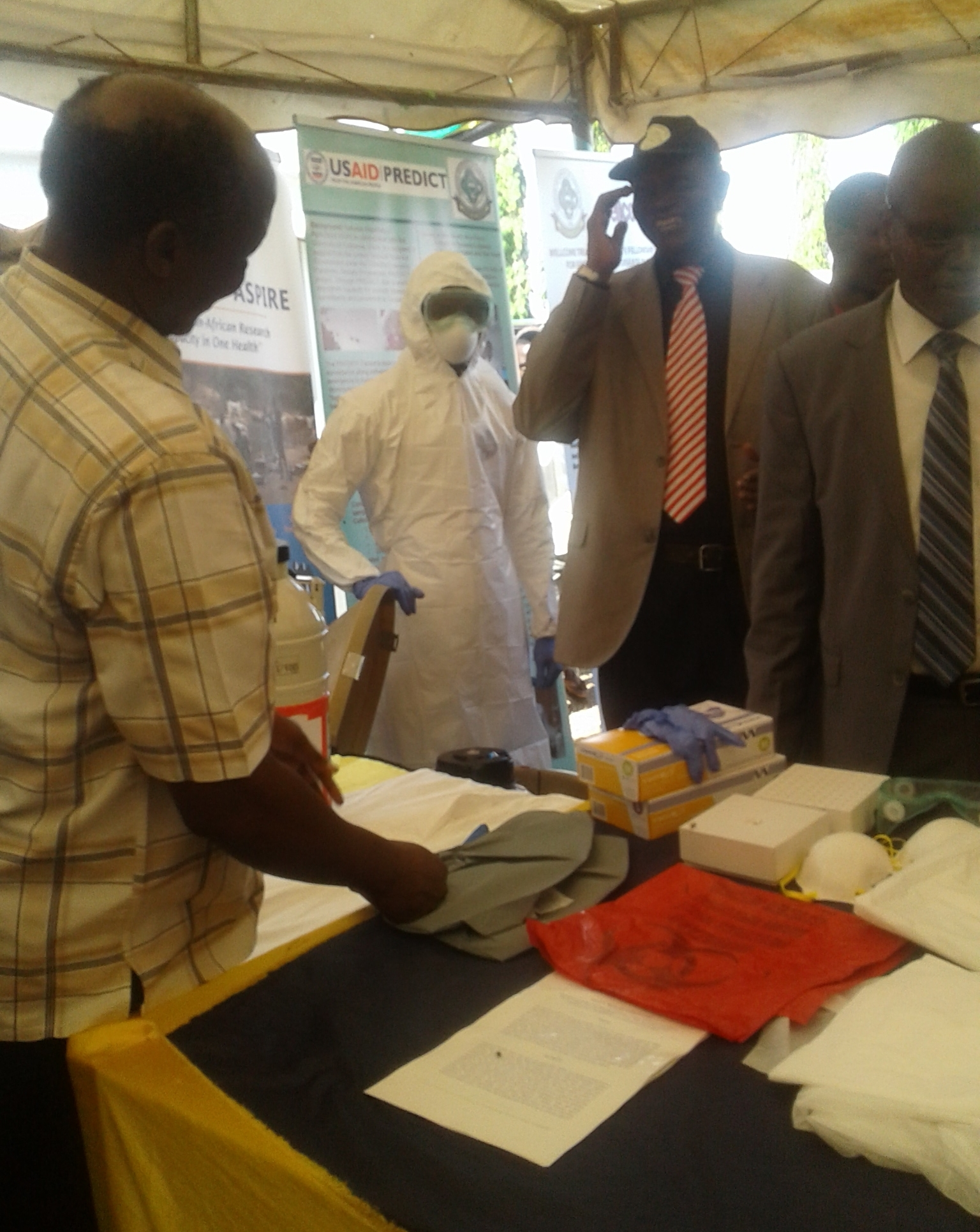 Prof. Kazwala on the lefT, Vice chancellor of Sokoine University of Agriculture on the right and Walter Simon in tyvek suit.