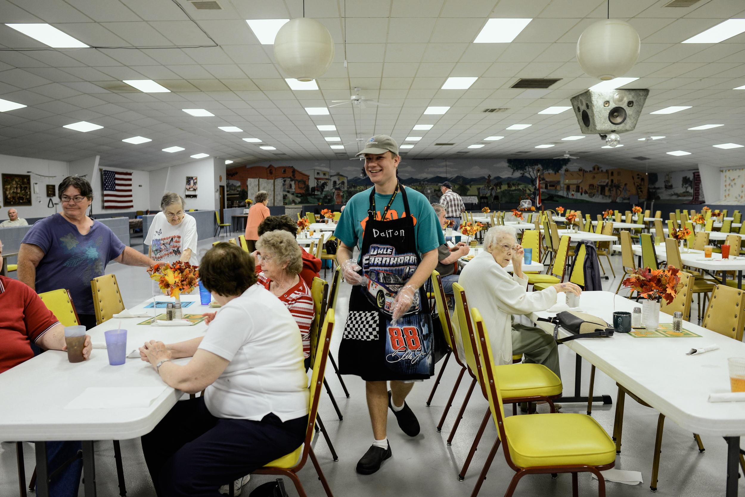 Trenton, Missouri. 2013.  Dalton helps serve lunch at the local senior center. He volunteers multiple times a week because he enjoys interacting with different members of the community.