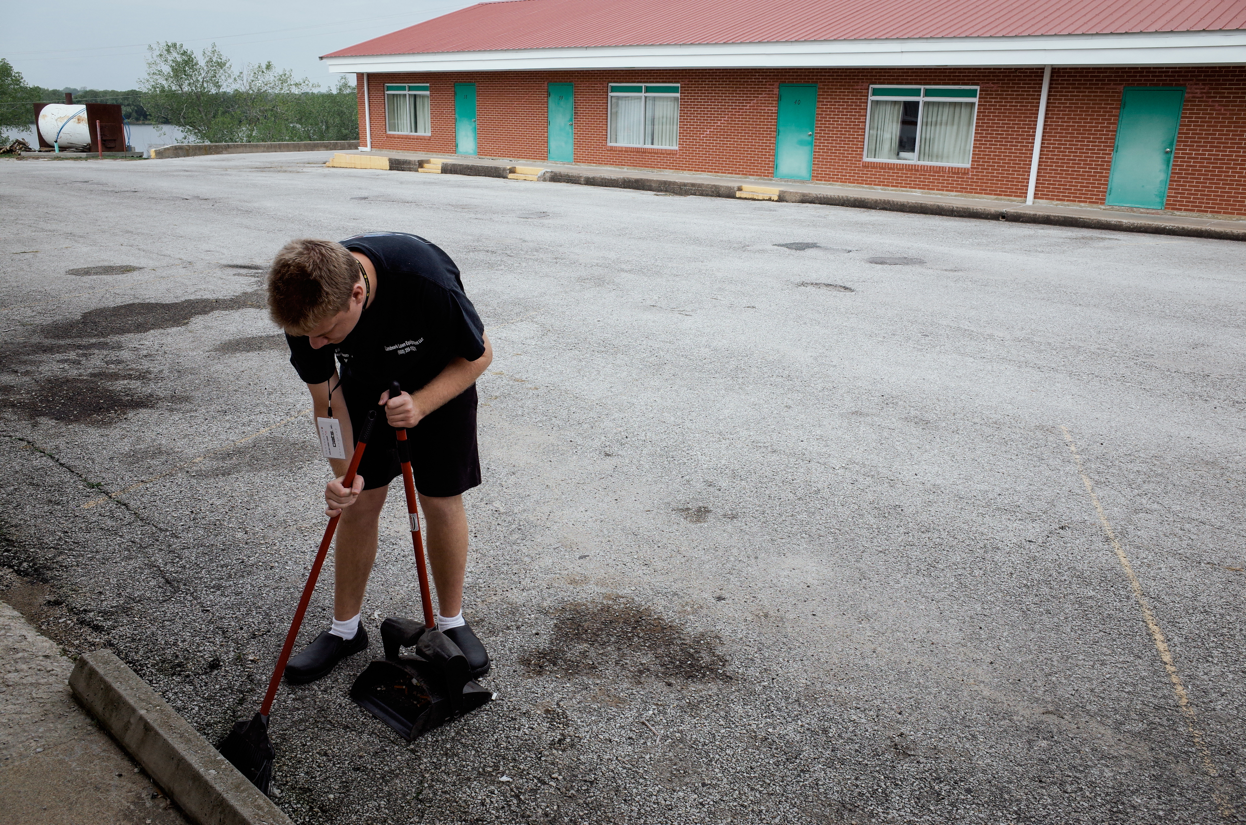 Trenton, Missouri. 2013.  Dalton sweeps at Lakeview Motor Lodge where he works one day a week helping in the restaurant and other tasks.