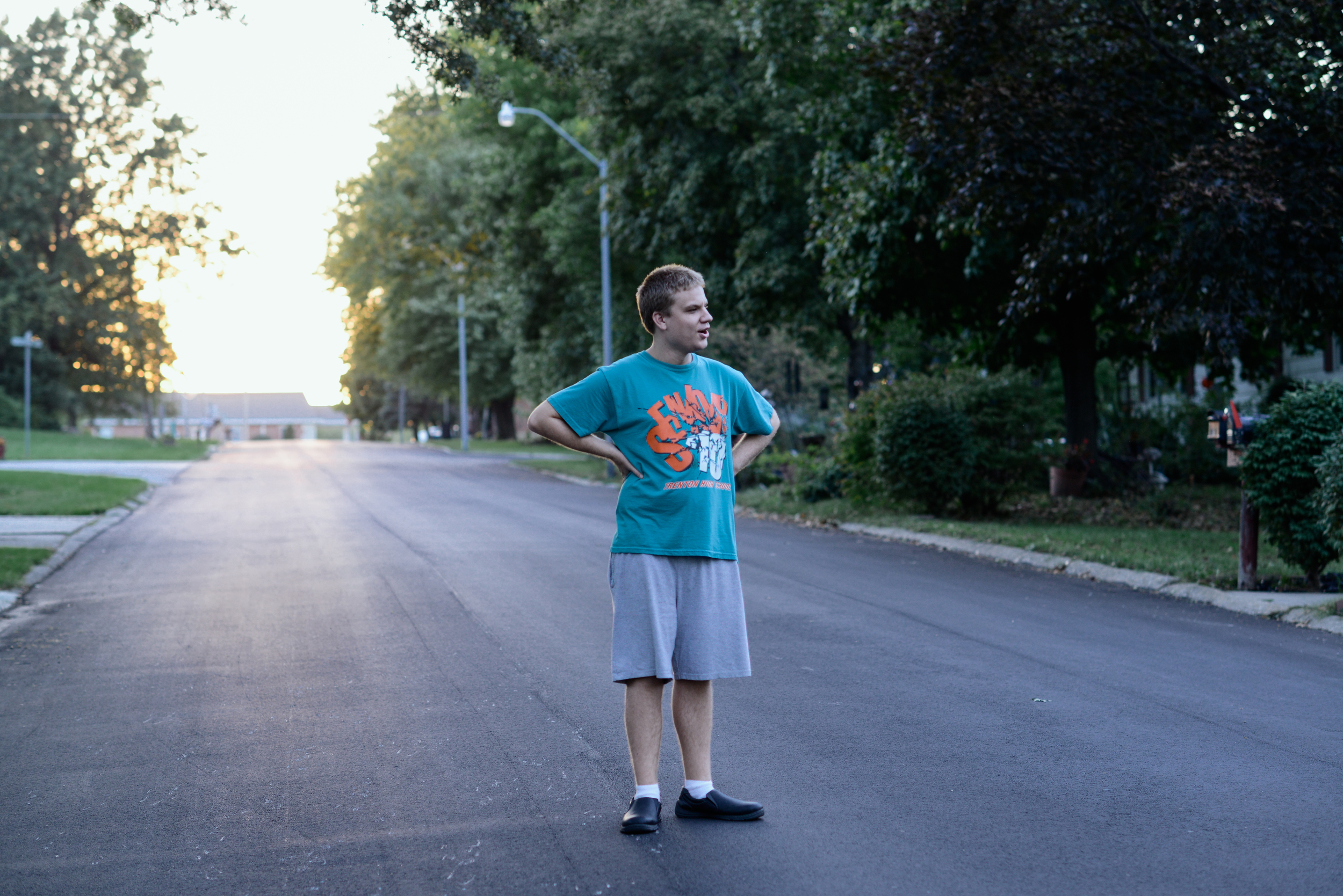 Trenton, Missouri. 2013.  Out on a walk near his home, Dalton visits with neighbors to talk sports and exchange trading cards.