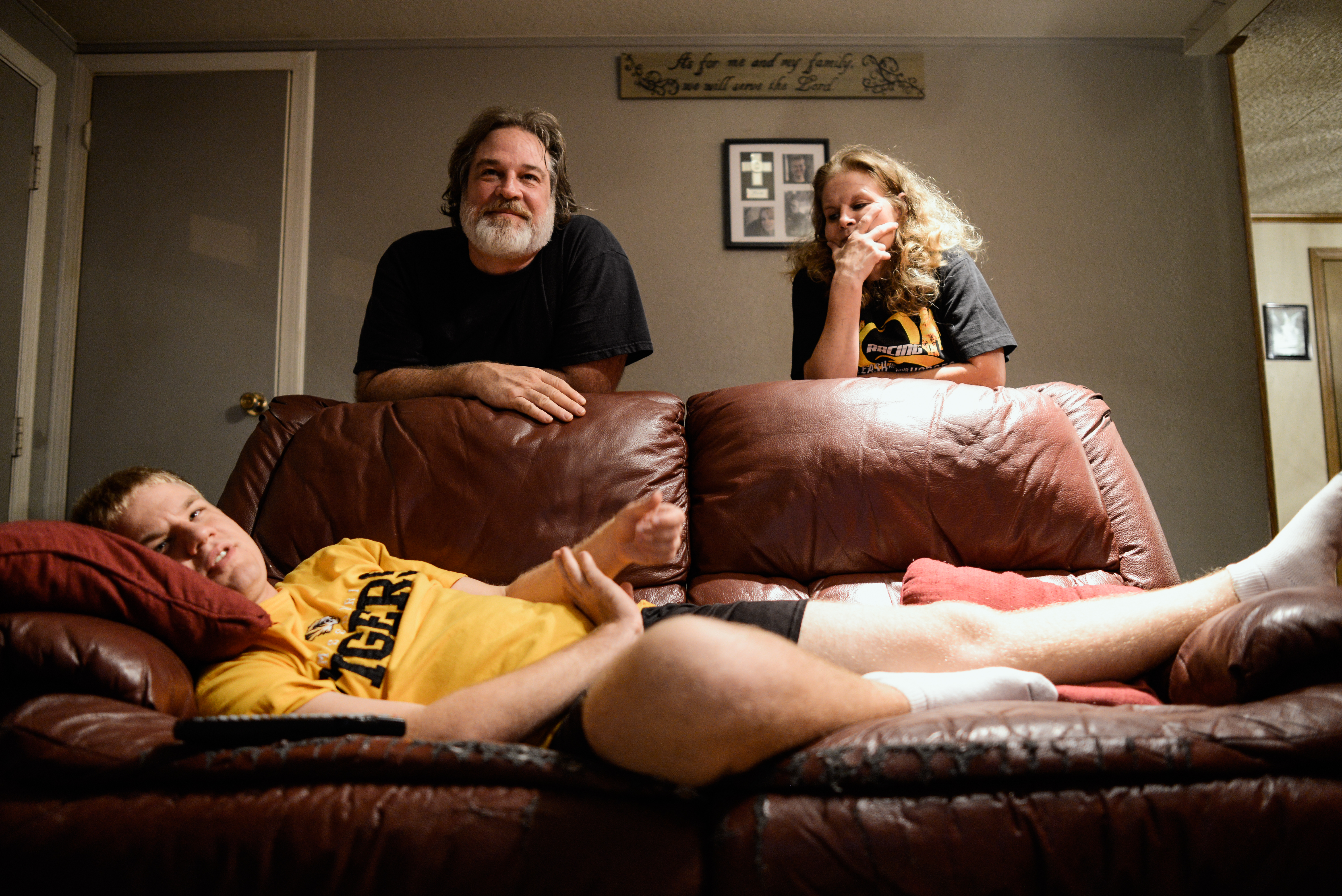 Trenton, Missouri. 2013.  A nightly ritual, Dalton and his parents, Casey and Joyce, spend some time together watching television.