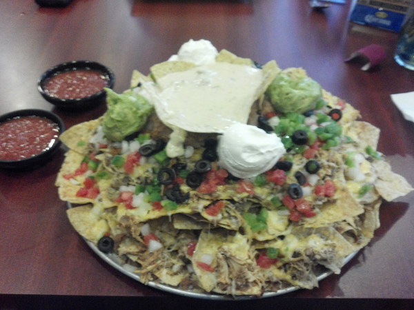 Beans,   Beef, Chicken, Pork, Monterey Jack and Cheddar Cheese, Tomatoes,   Onions, Green Peppers, Black Olives, Sour Cream, Guacamole, Queso.