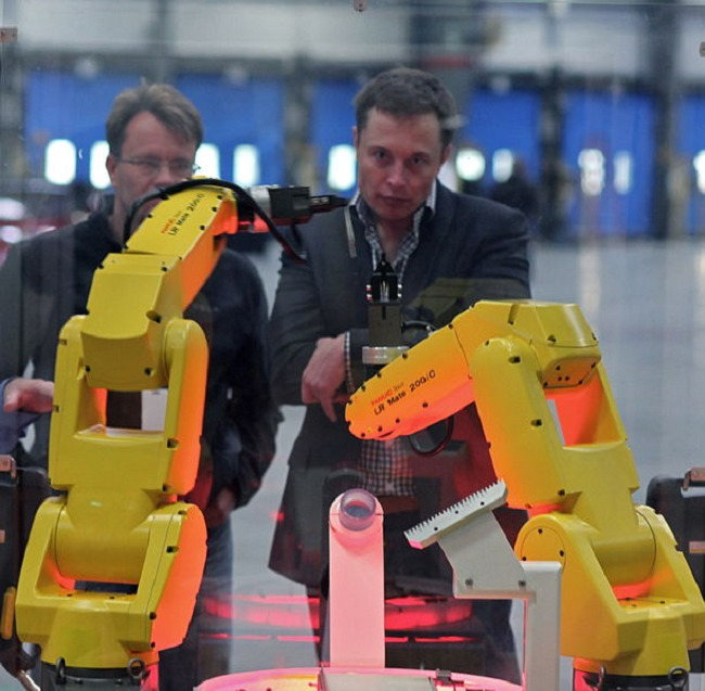 Steve Jurvetson took this picture of what I can only assume are robots bowing down to Elon.