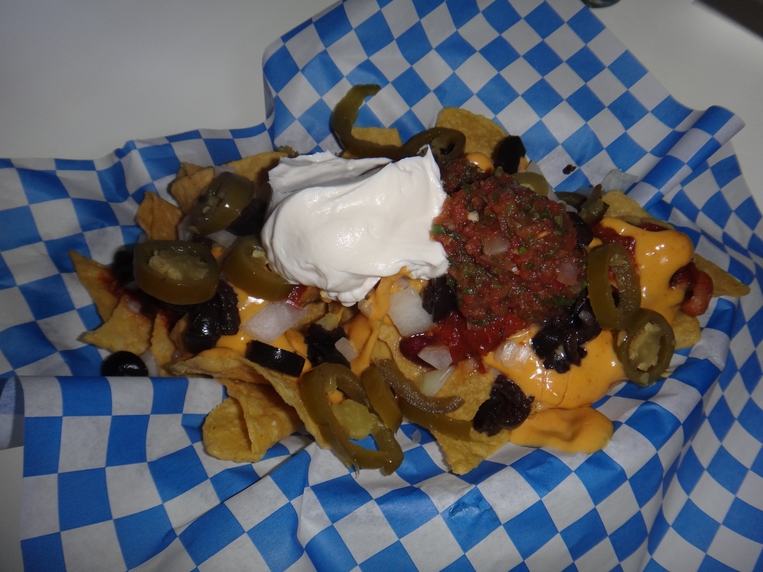 Chili, Spicy Cheese, Onions, Olives, Jalapeños, Salsa, Sour Cream.