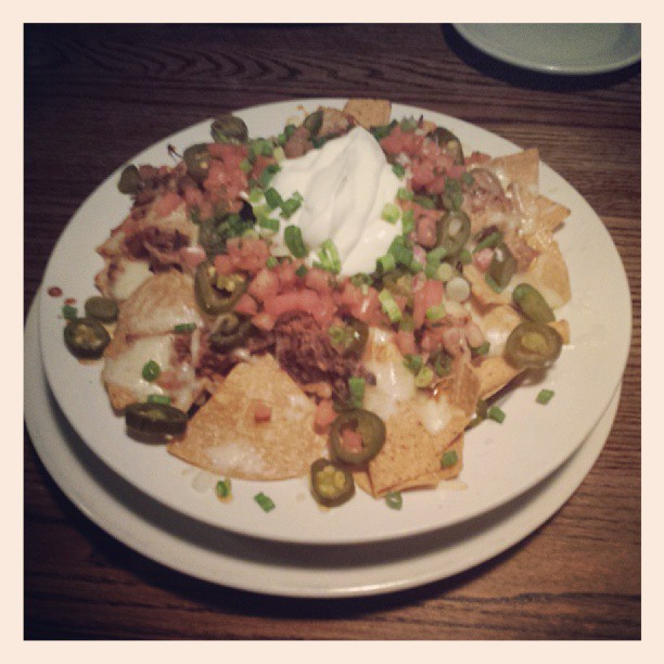 Tortilla Chips, Cheddar Cheese, Jalapeno, Green Onion, Salsa Fresca, Sour Cream, Pulled Pork