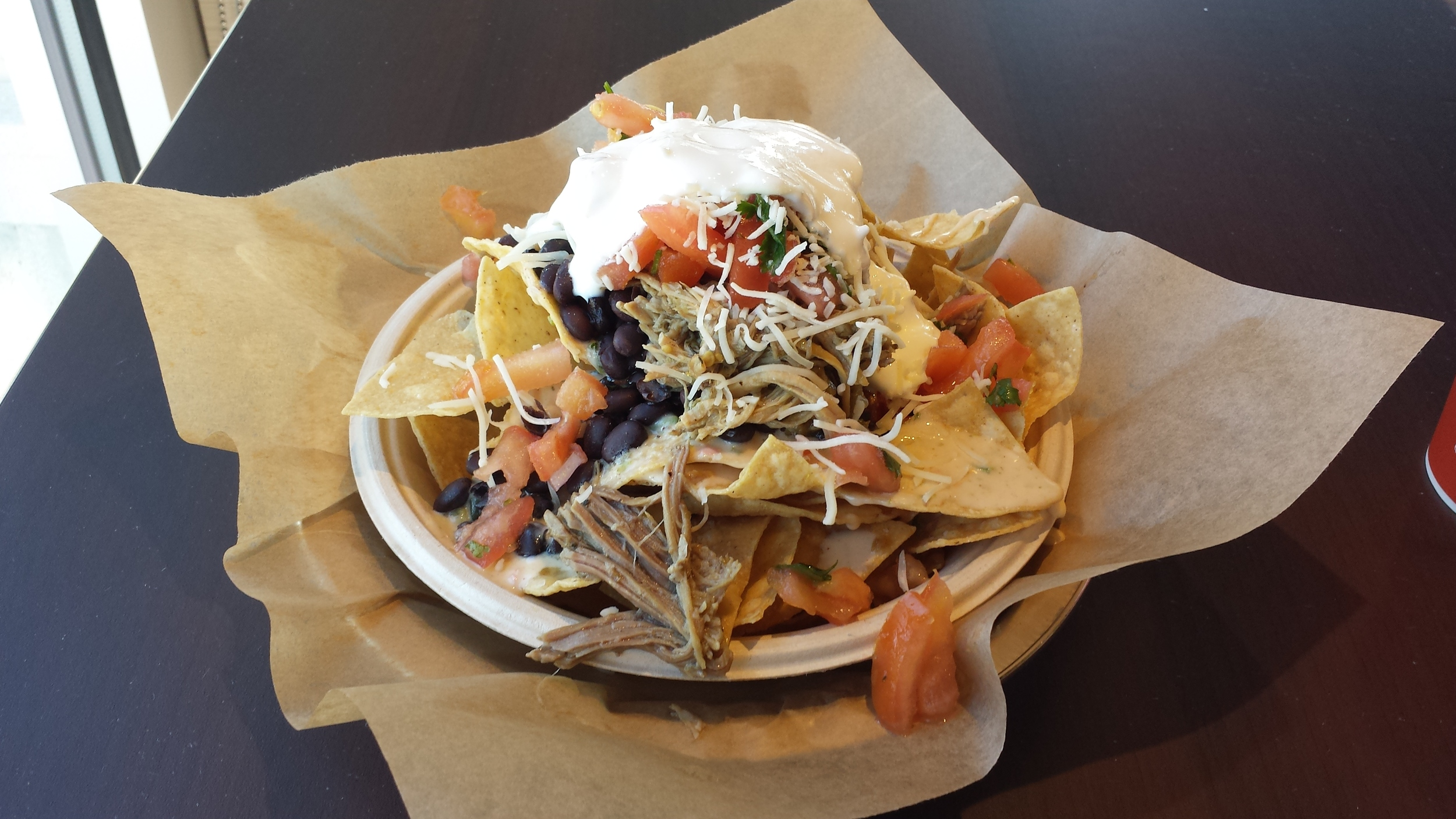 Handmade Tortilla Chips, Black Beans, Pulled Pork, 3-Cheese Queso, Pico de Gallo, Shredded Cheese, Sour Cream