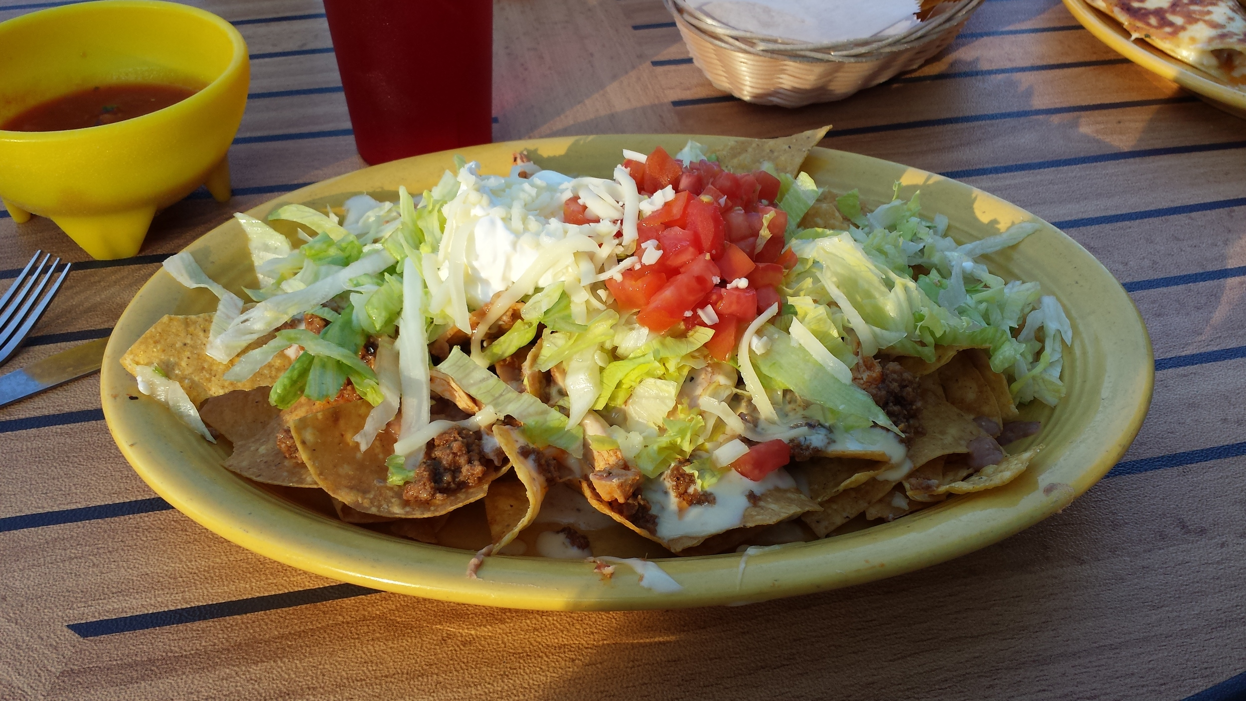 Beef, Chicken, Refried Beans, Shredded Cheese, Queso, Lettuce, Tomatoes, Sour Cream