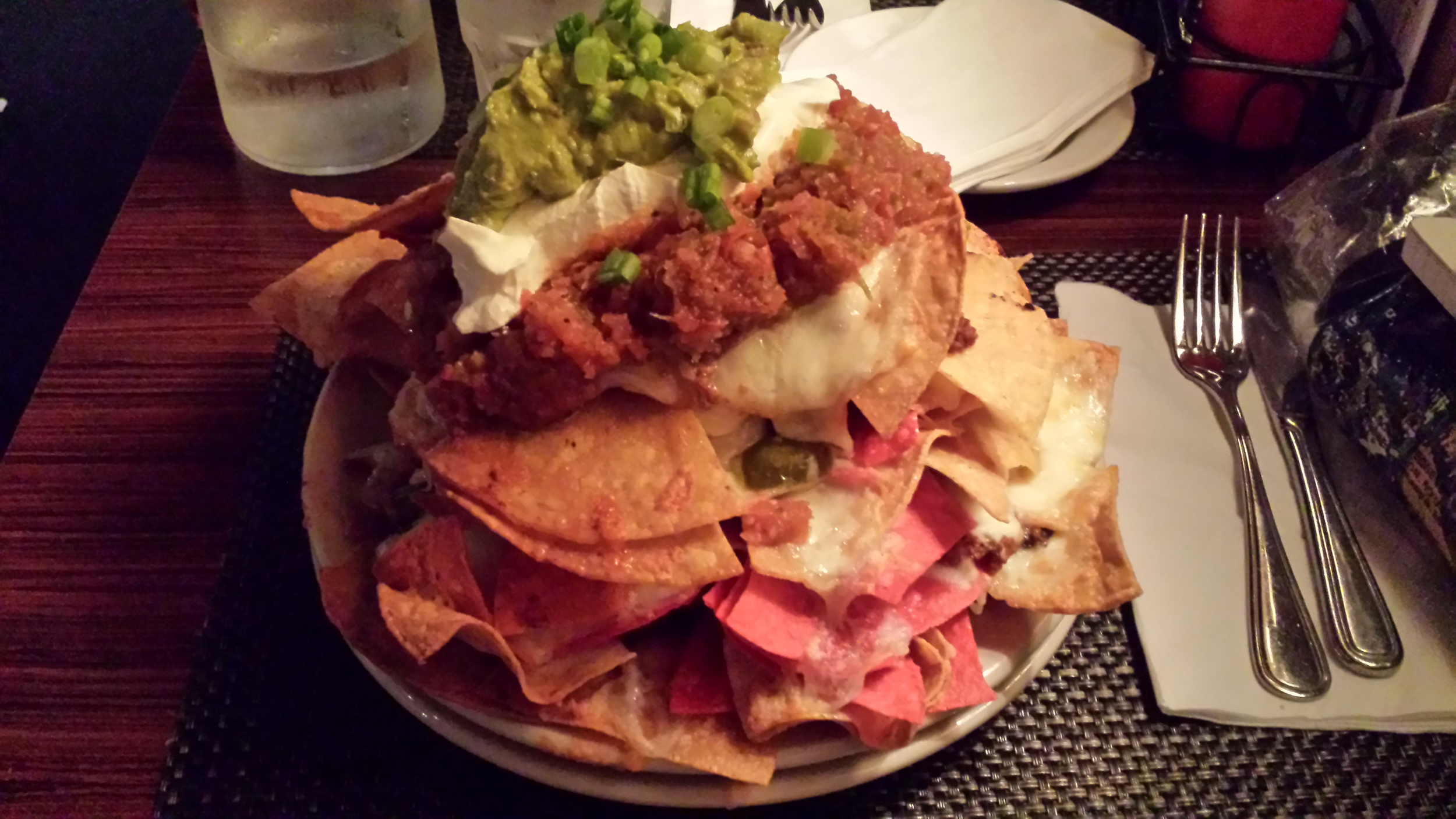 Hand cut tortilla chips, Hereford chili, Monterey jack cheese, jalapeños, sour cream, salsa , g uacamole