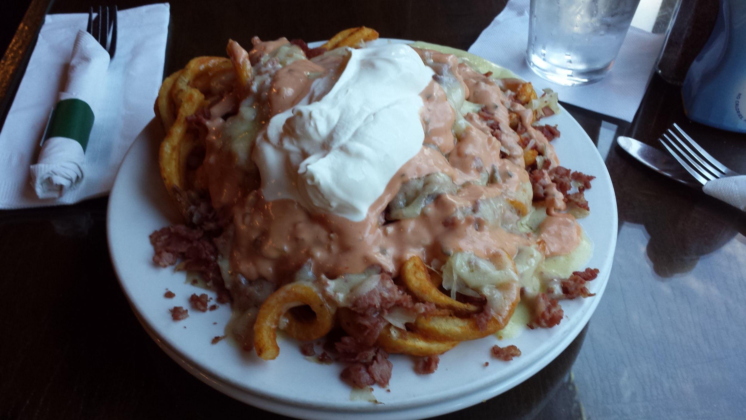 Seasoned Curly Fries, Corned Beef, Swiss Cheese, Sour Cream, Thousand Island Dressing, Sauerkraut