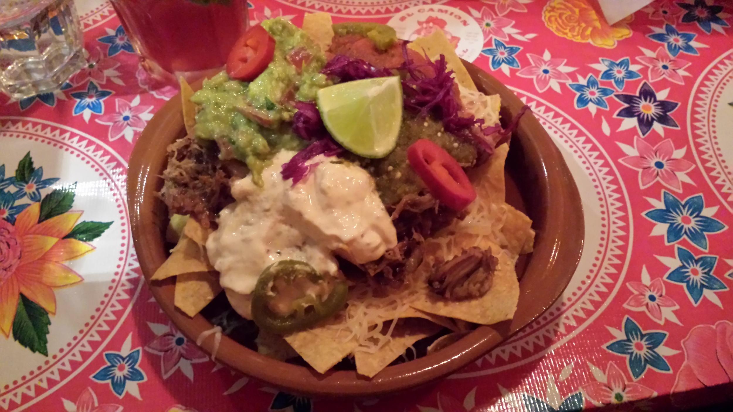 Melted Jack Cheese, Guacamole, Salsa, Sour Cream, Pork Carnitas, Jalapenos