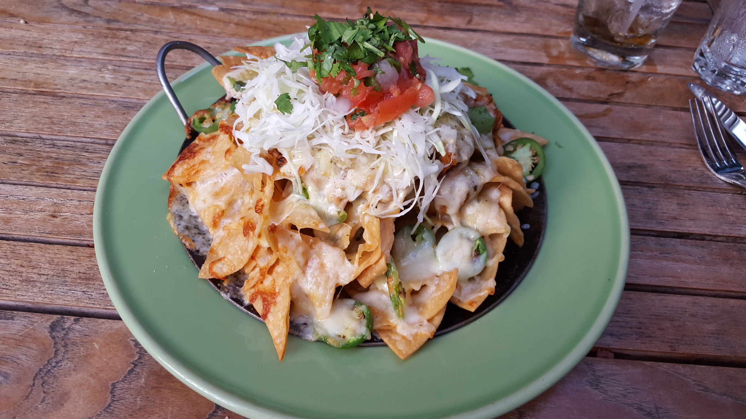 House made tortilla chips, chipotle cheese sauce, salsa verde, roasted chicken, sliced jalapeño, fresh pico-de-gallo