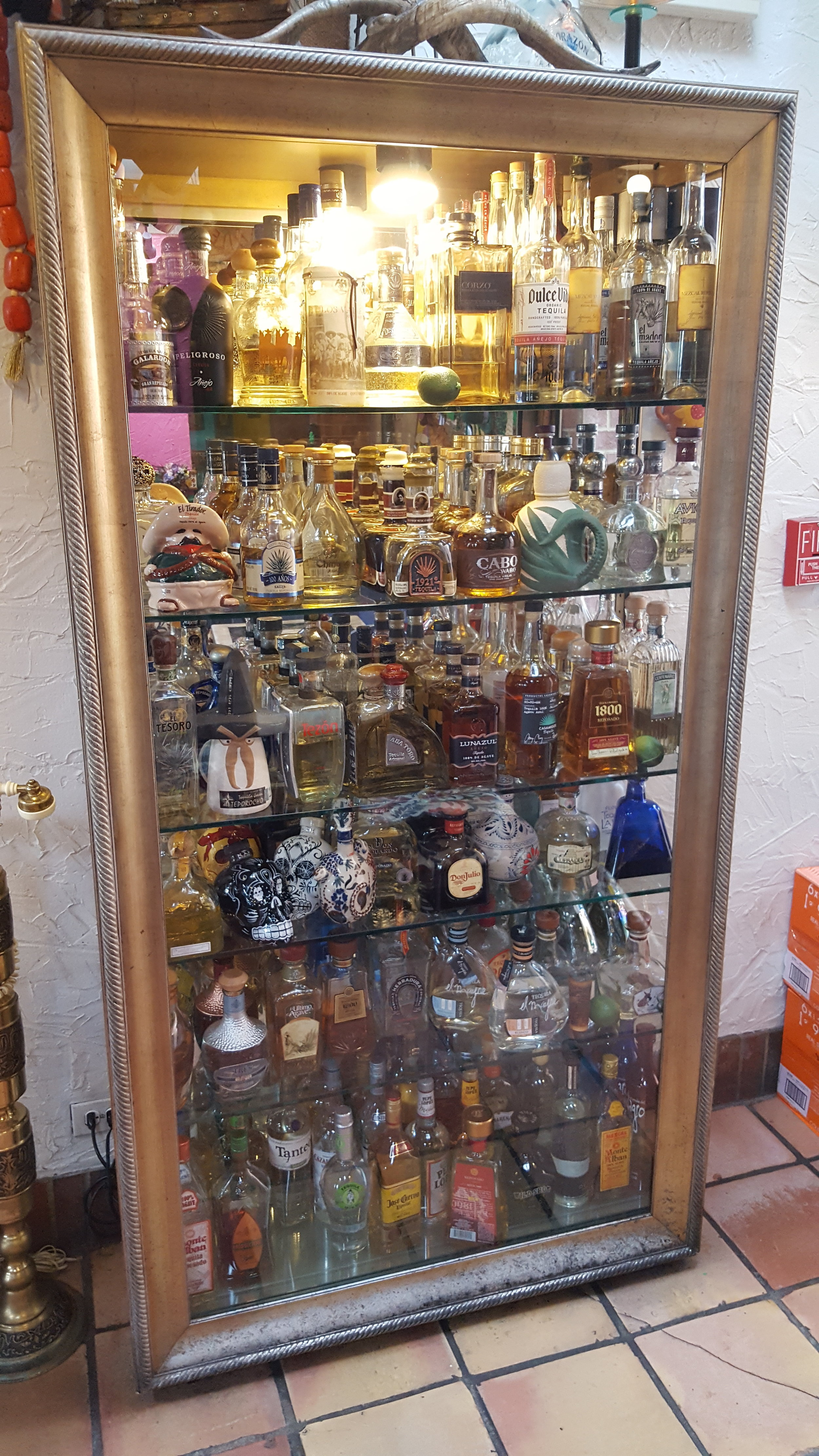 One of 3 or 4 tequila display cases.