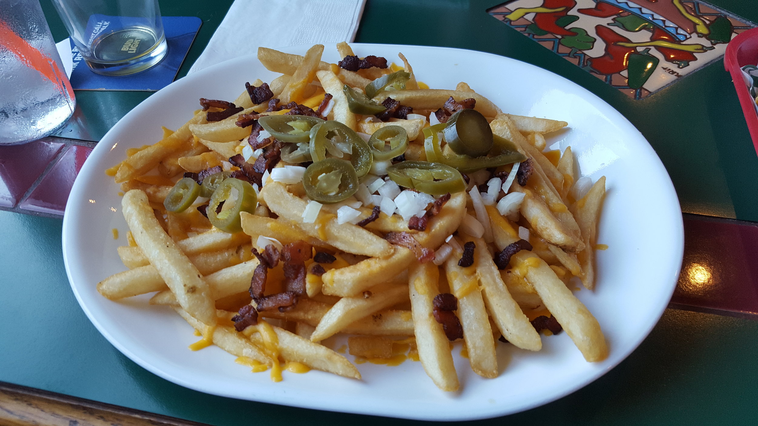 French Fries, Shredded Cheese, Bacon, Onions, Jalapenos, Olives