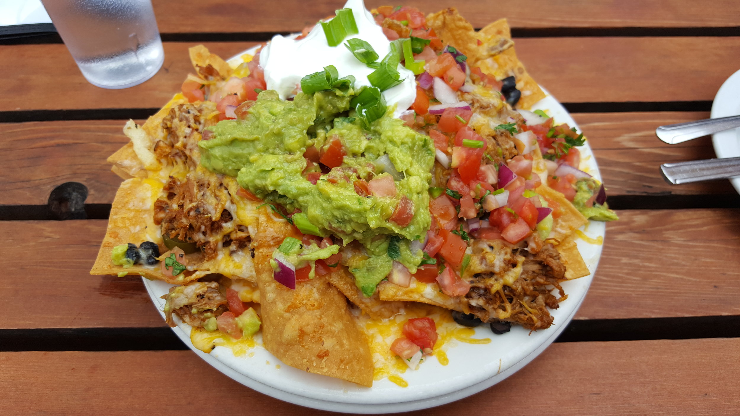 Cheddar and Jack Cheeses, Pico de Gallo, Black Beans, Pickled Jalapenos, Guacamole, Sour Cream, Pulled Pork