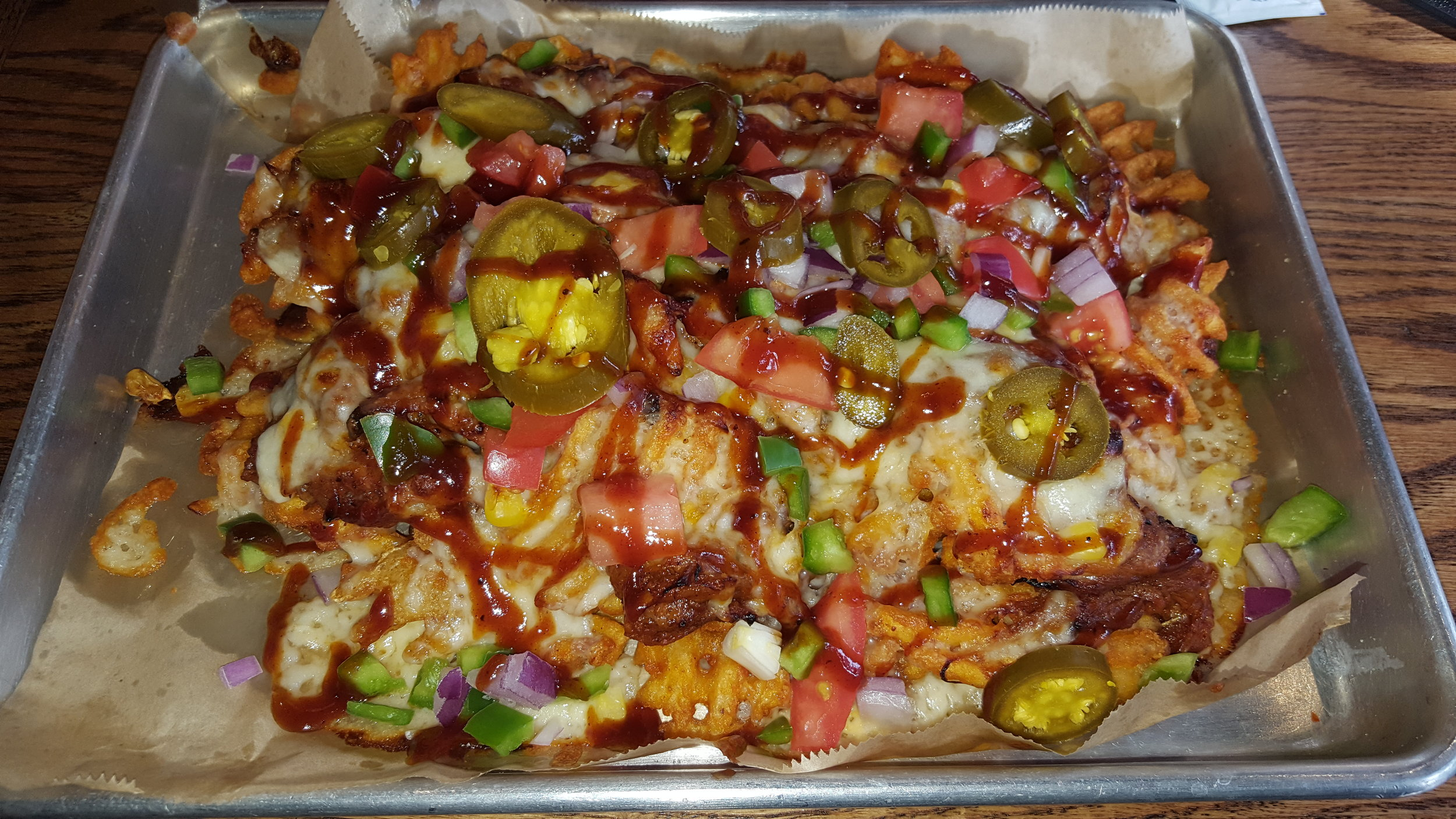 Pulled Pork, Onions, Peppers, Cheddar, Sweet Corn, Jalapenos, Tomato, BBQ Sauce, Sour Cream