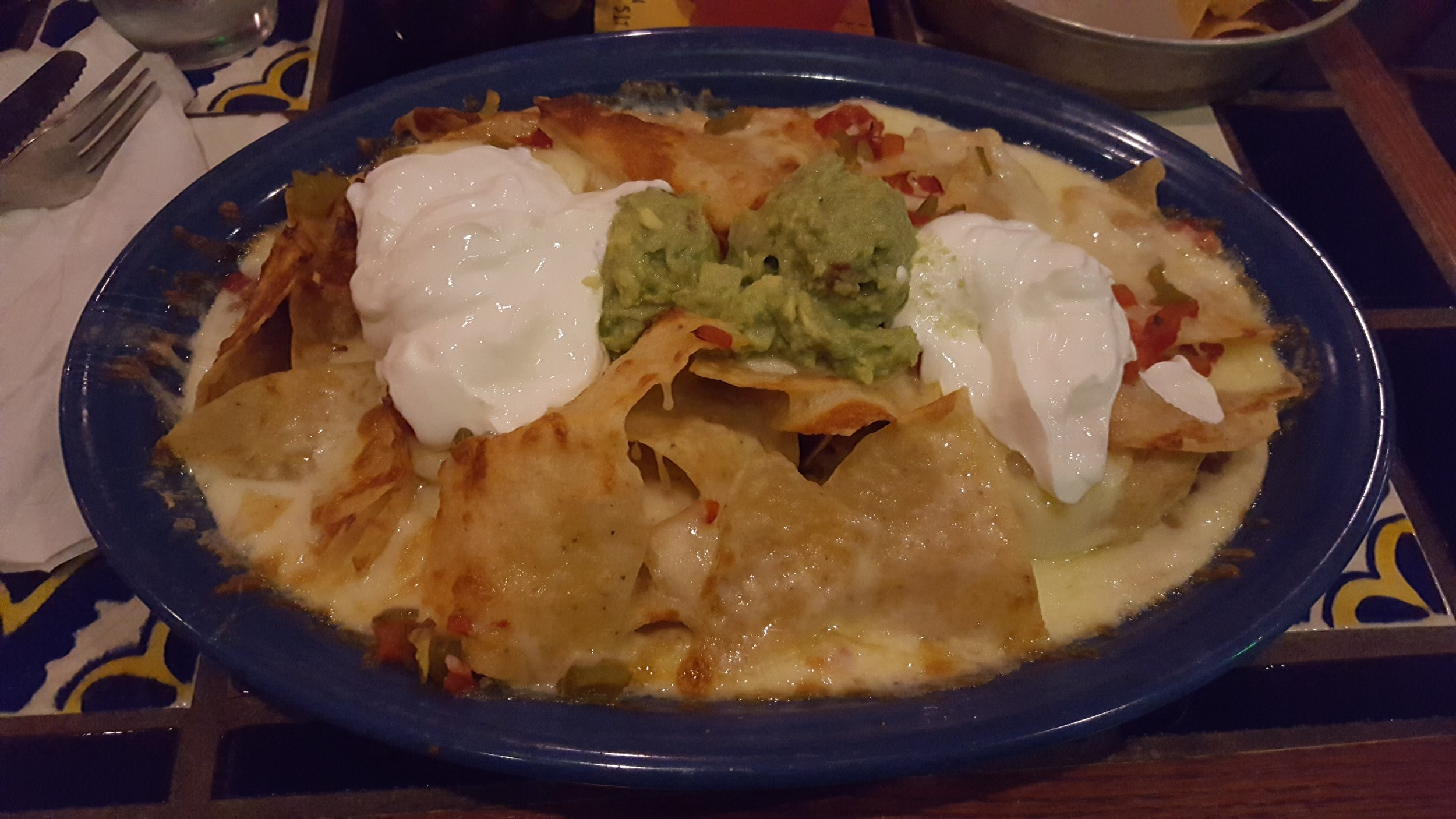 Chips, Cheese, Refried Beans, Red and Green Chilies, Guacamole, Sour Cream
