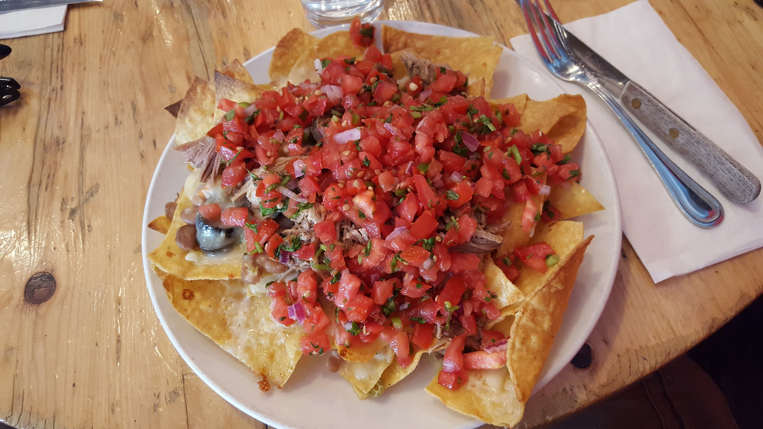 Tortilla Chips, Chihuahua Cheese, Spicy Chopped Pickled Vegetables, Olives, Pinto Beans, Pico de Gallo, Pulled Pork
