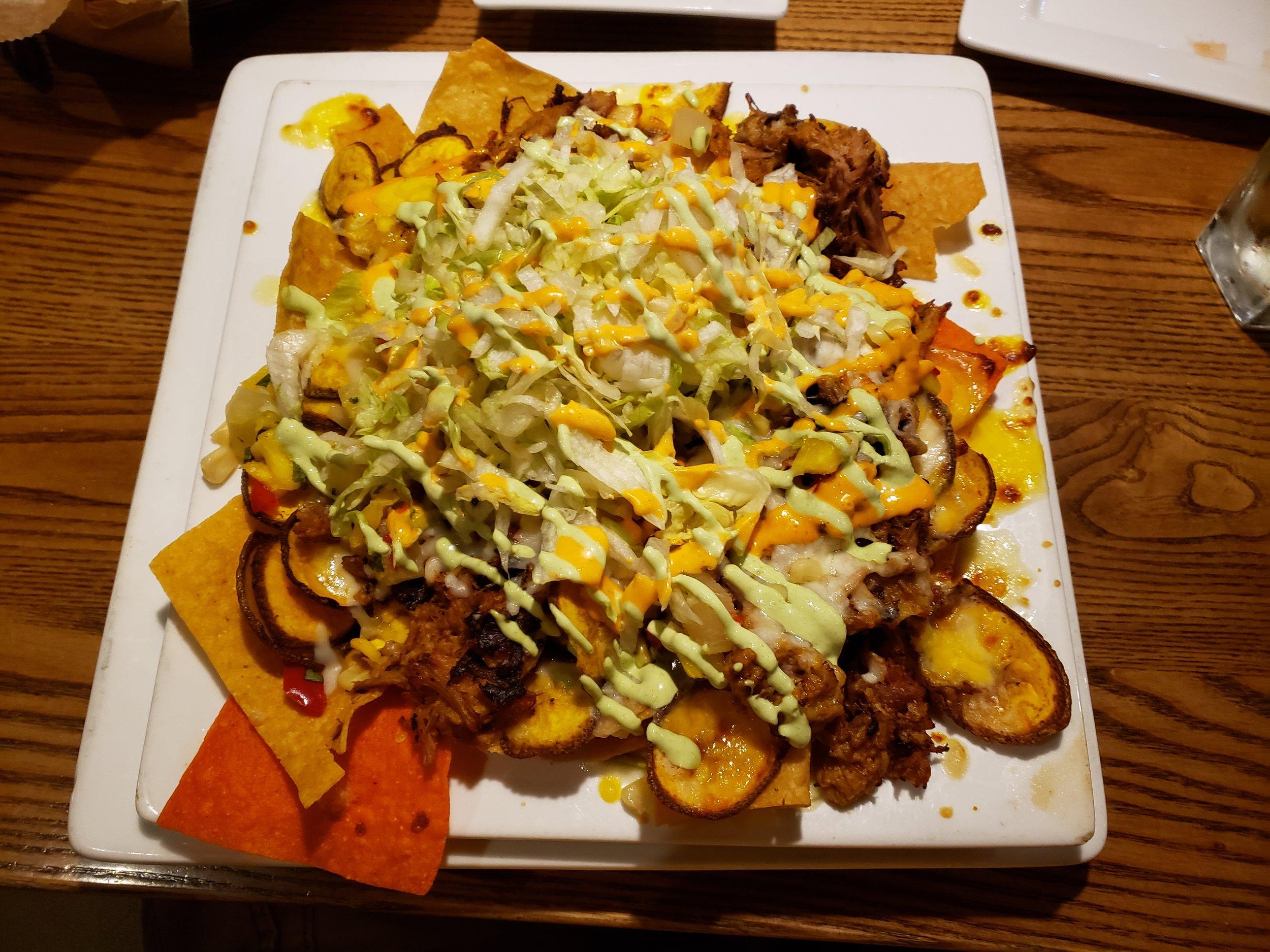 Barbacoa Pork, Pineapple Salsa, Plantain Chips, Chipotle BBQ, Jack Cheese, Lettuce, Cilantro Crema, Sriracha Aioli