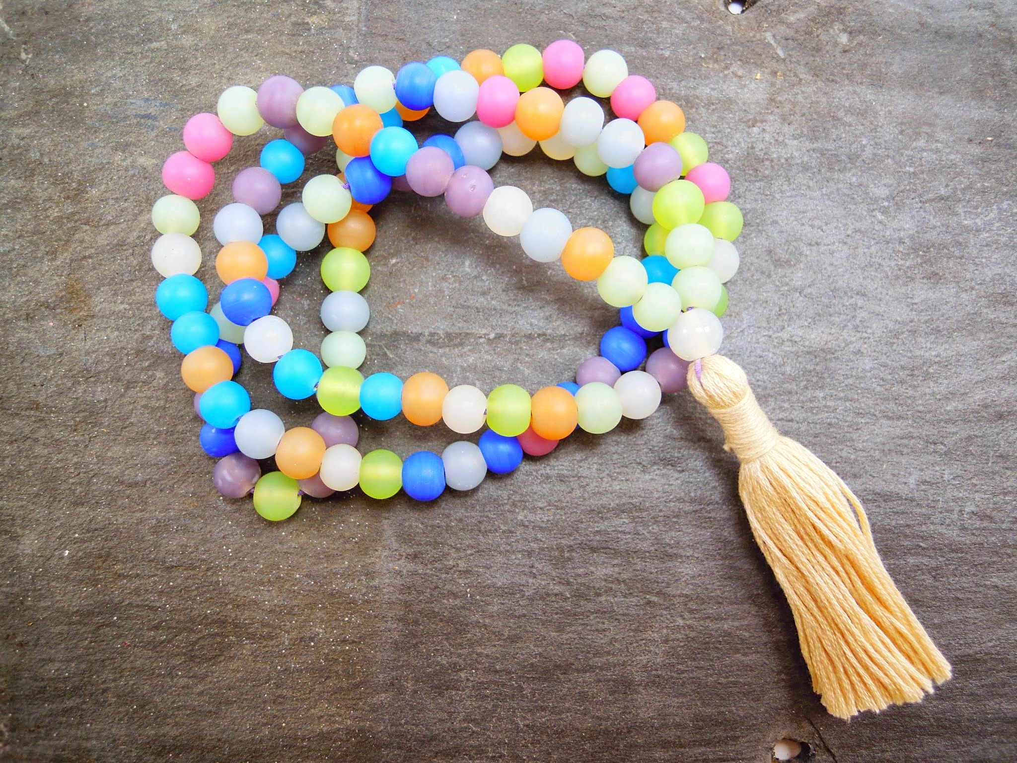 Spring Eternal Mala with handmade tassel. This mala is strung on stretchy cord so you can easily wrap it around your wrist.