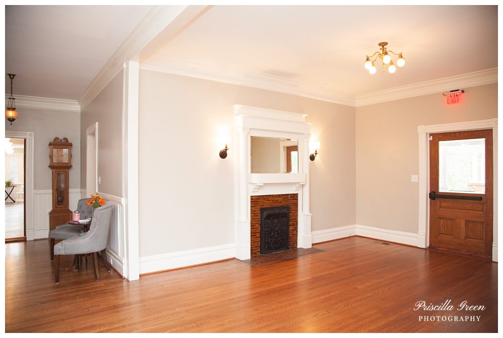 To the right is an empty room perfect for reception seating or bar.