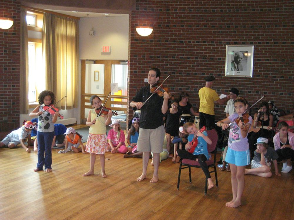 From last year's camp: leading a small string ensemble, rehearsing for the Bates Finale Concert!