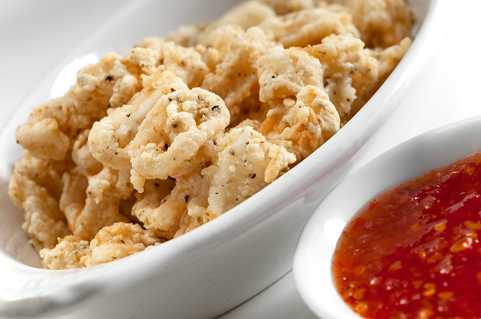 CALAMARI     Flash Fried with Marinara Sauce.