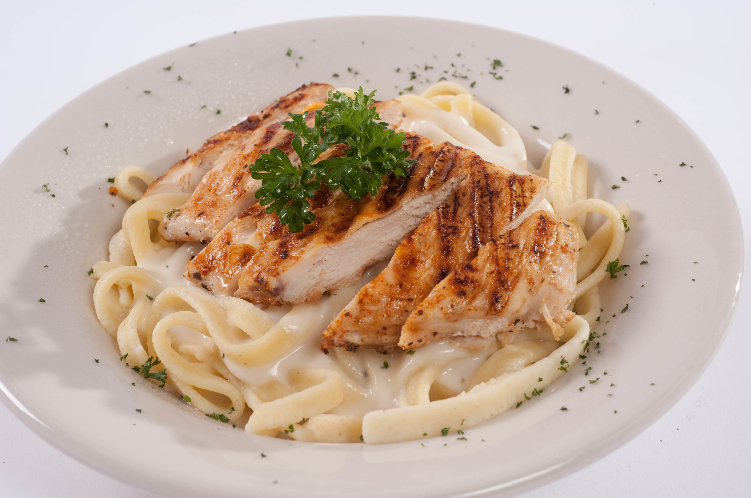 CHICKEN FETTUCCINE ALFREDO     Tossed in a Creamy Parmesan Butter Sauce.