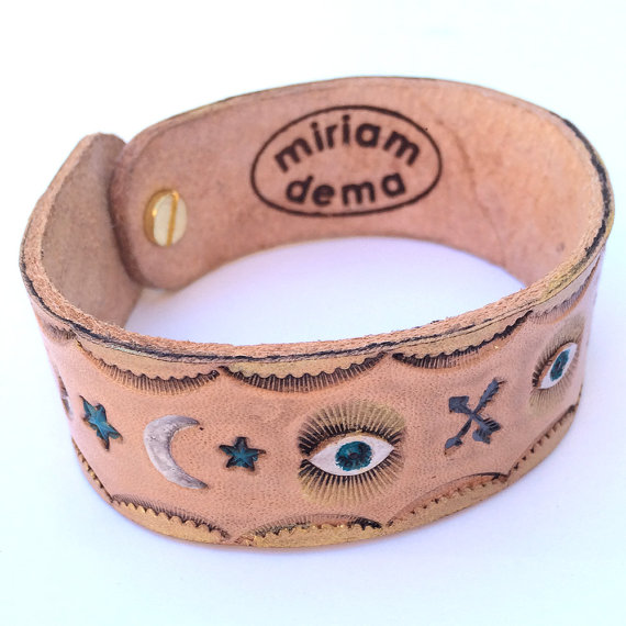 #ahasmember Miriam Dema does a great job of branding this leather cuff she made so that people know who made it even if they were given it as a gift or forget her name later.