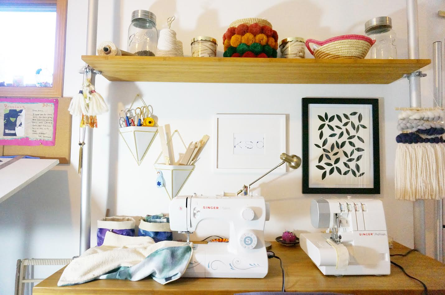 My favorite studio addition is my sewing/serging station. It is such a time saver being able to keep my machines handy all the time. Plus the upper shelf provides additional storage for product supplies, such as zippers.