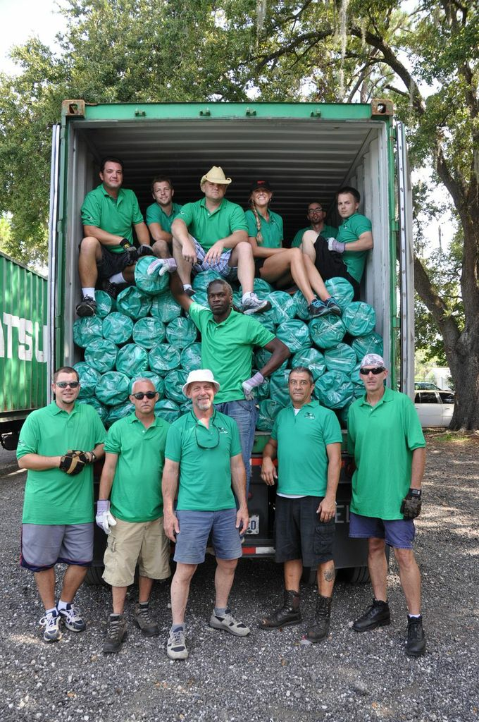 The Temporary Repair team with rolls of tarp ready to help you when disaster strikes.