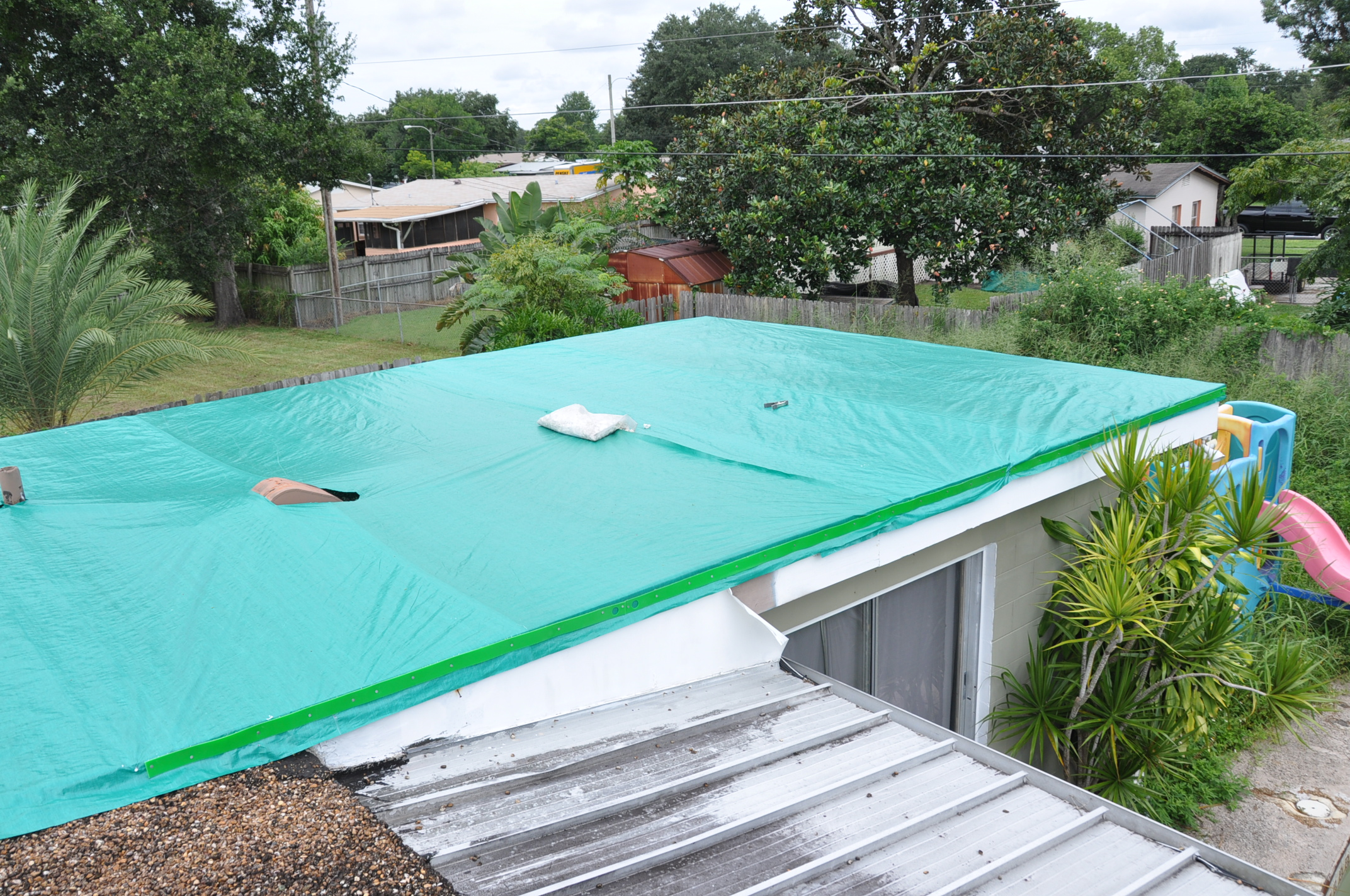 How to install a roof tarp on a gravel roof  — Orlando Roof